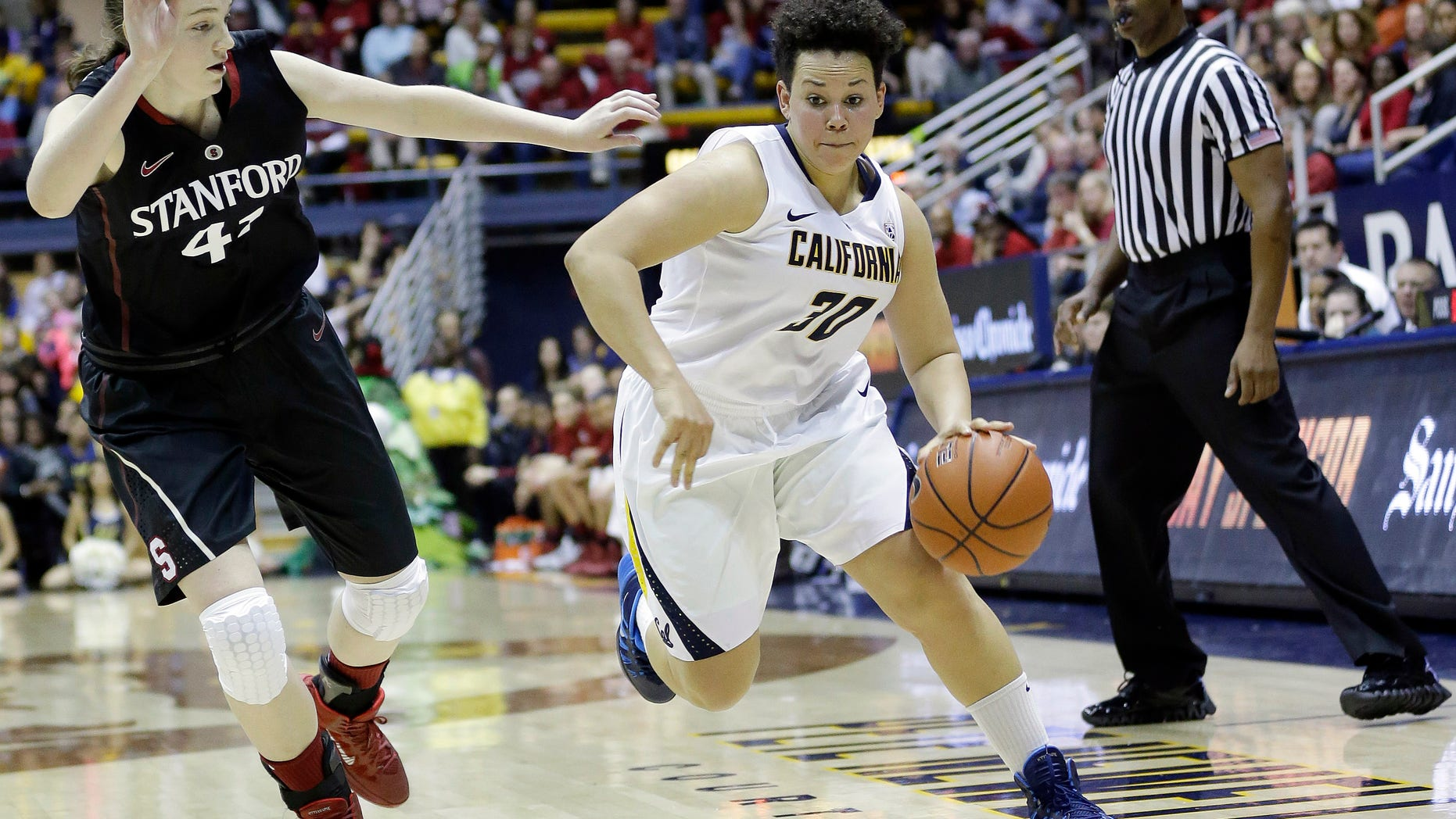 In this photo taken on Feb. 2, 2013, California guard Mikayla Lyles (30) dribbles past Stanford forward Bonnie Samuelson during the second half on an NCAA college basketball game in Berkeley, Calif. Lyles moved into the starting lineup for the first time in her four-year California career during a pair of games against rival Stanford last week, and did everything to show she belongs by knocking down clutch shots and making key hustle plays. (AP Photo/Marcio Jose Sanchez)