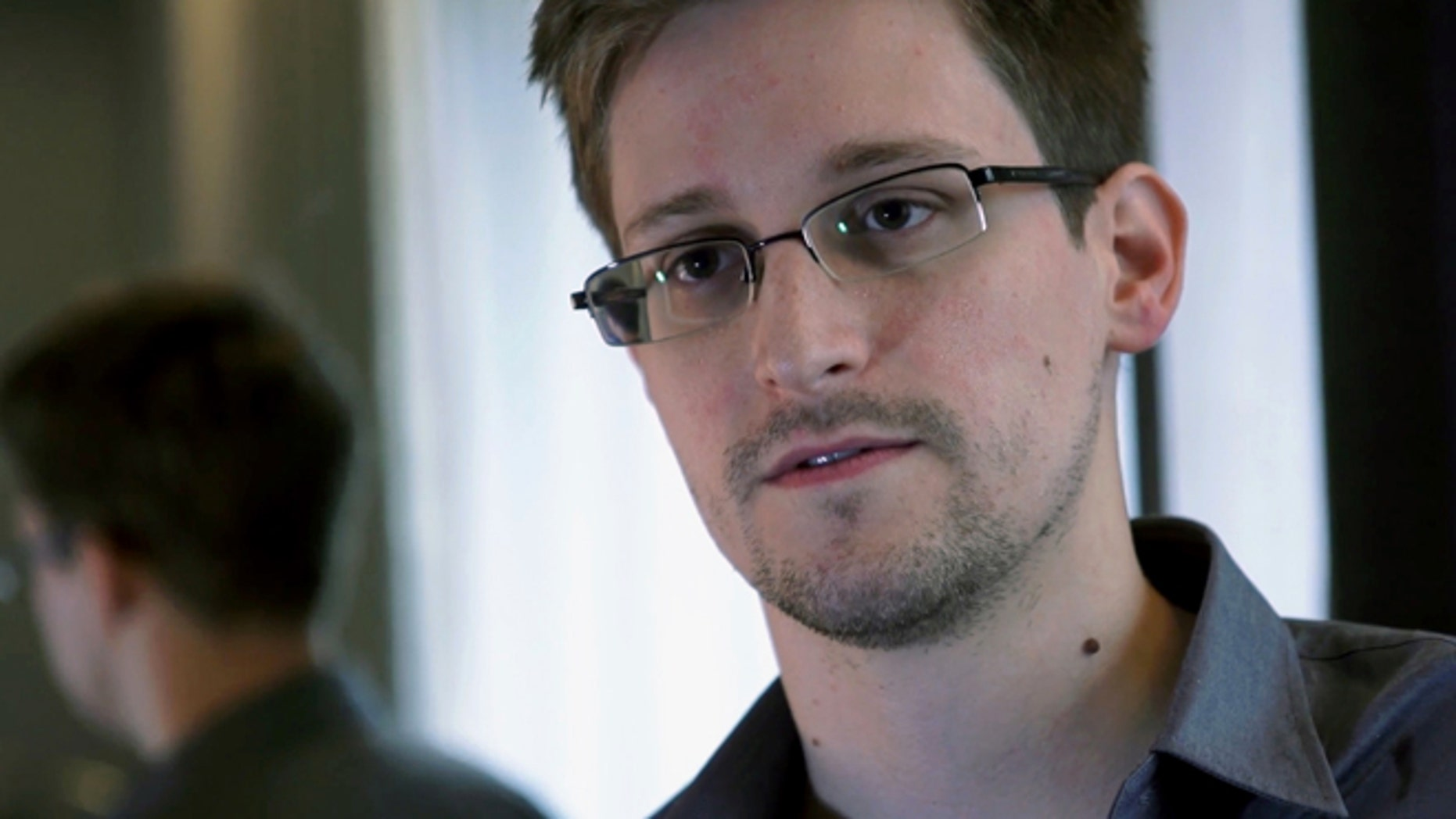 June 9, 2013: This photo provided by The Guardian shows Edward Snowden, who worked as a contract employee at the U.S. National Security Agency, in Hong Kong.