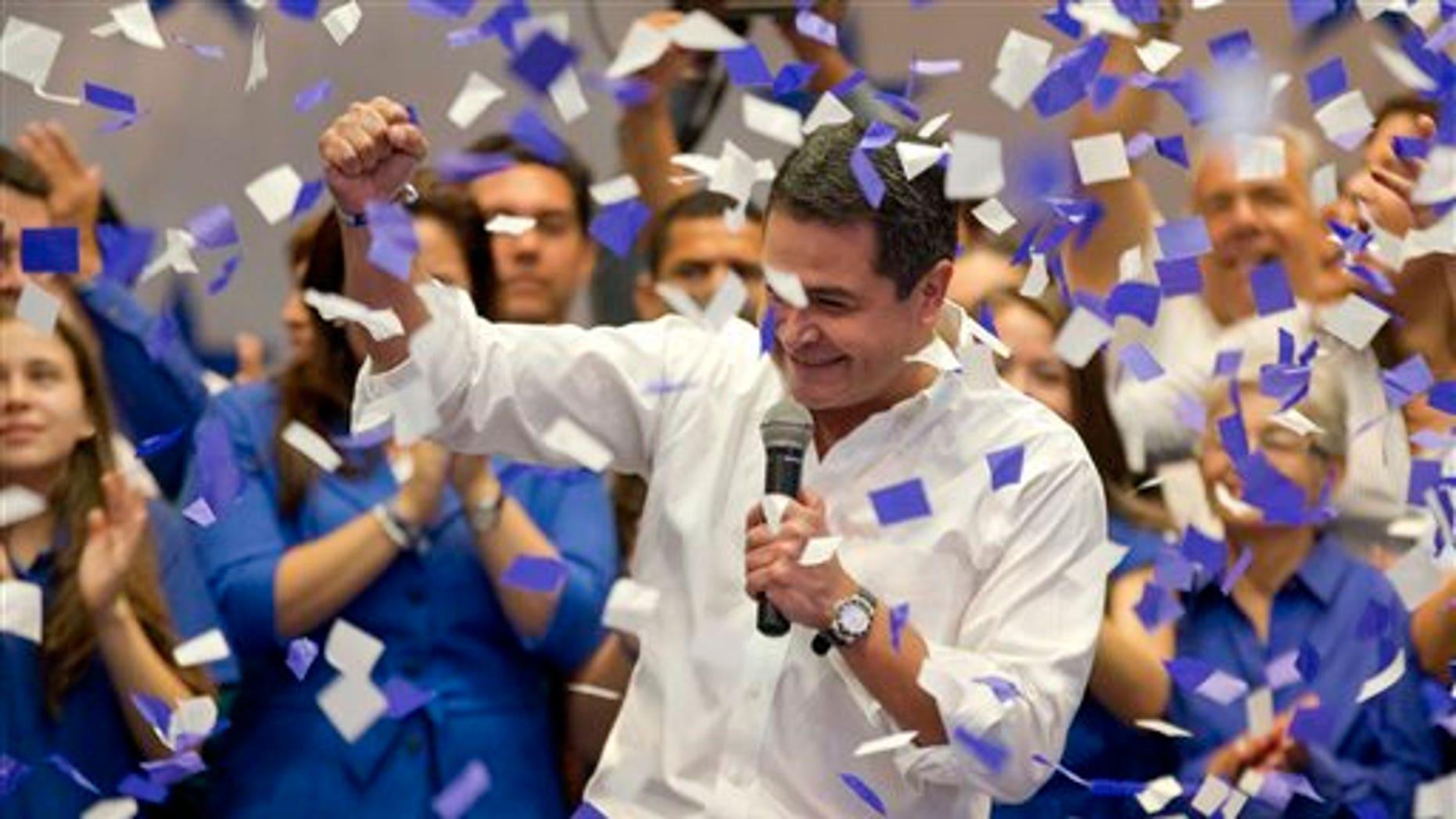 National Party's Juan Orlando Hernandez after partial election results in Tegucigalpa, Honduras, Sunday, Nov. 24, 2013.
