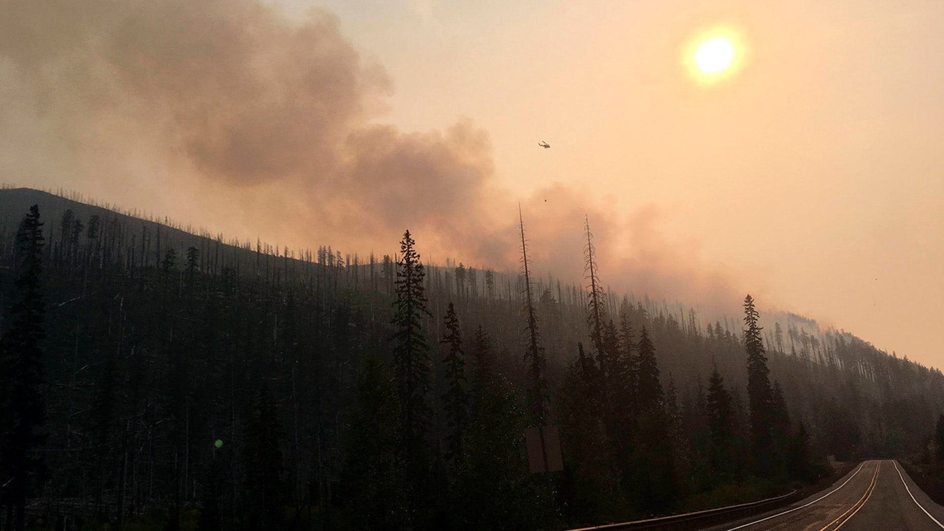 The smoke from massive wildfires hangs like fog over large parts of the  U.S. West, an irritating haze causing health concerns, forcing sports teams  to ...