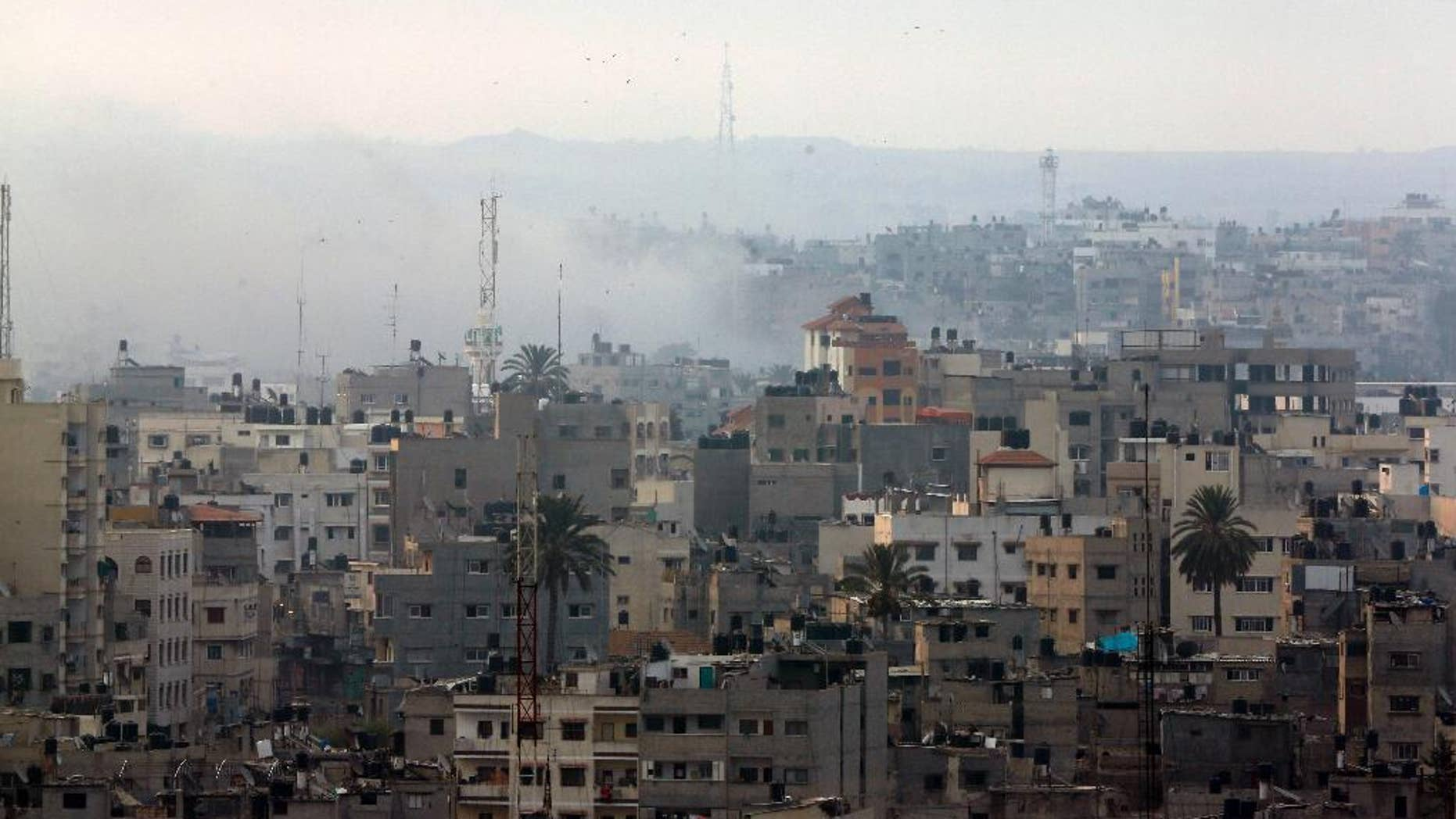 Smoke from Israeli strikes rises over Gaza City , northern Gaza Strip, Sunday, July 20, 2014. Israel said it widened its ground offensive early Sunday, sending more troops into Gaza after demolishing more than a dozen Hamas tunnels and intensifying tank fire on border areas. Since the start of Israel-Hamas fighting almost two weeks ago, over 300 Palestinians were killed and 2,700 wounded in Israeli air and artillery strikes, according to Palestinian health officials. One-fourth of the deaths were reported since the start of the ground offensive late Thursday, the officials said.(AP Photo/Lefteris Pitarakis)