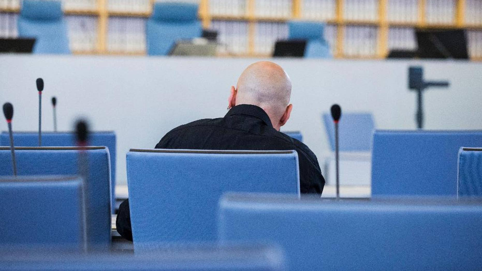 FILE - In this June 22, 2016 file picture accused Frank S. sits in a courtroom of the higher regional court in Duesseldorf, Germany.  A German federal court has rejected an appeal Monday Jan. 9, 2017 by a far-right extremist sentenced to 14 years in prison for the attempted murder of a politician who is now Cologne's mayor. The defendant, identified only as Frank S. in line with German privacy rules, was convicted by a Duesseldorf court in July. Henriette Reker, who was in charge  of housing refugees in Cologne at the time, was stabbed in the neck Oct. 17, 2015 as she campaigned.  (Rolf Vennenbernd/dpa via AP, file)