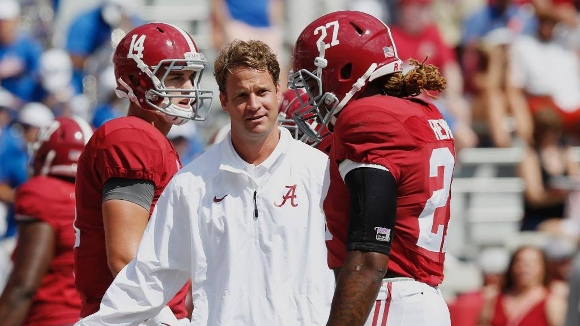 Alabama's offensive coordinator Lane Kiffin, centerr, gestures at running back Derrick Henry (27) before an NCAA college football game against Florida, Saturday, Sept. 20, 2014, in Tuscaloosa, Ala. (AP Photo/Brynn Anderson)