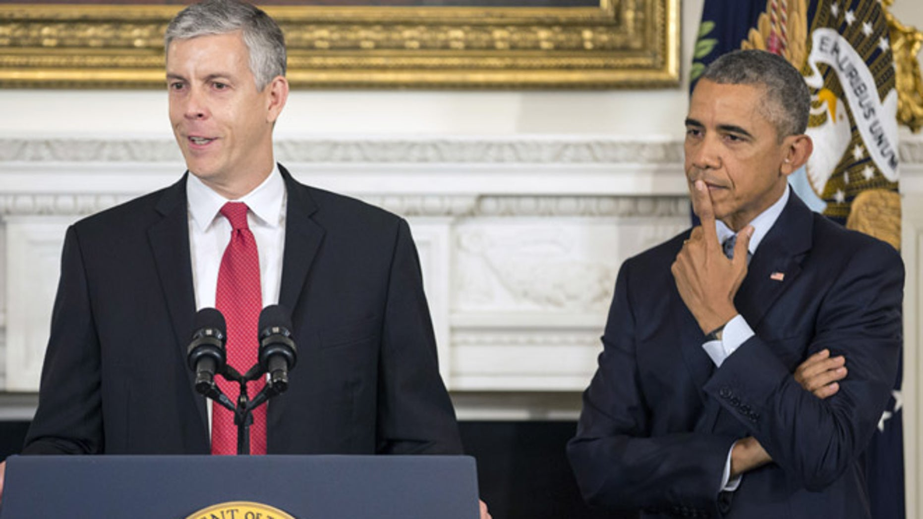 October 2, 2015: U.S. President Barack Obama listens as U.S. Secretary of Education Arne Duncan announces his resignation in the State Dinning Room of the White House in Washington.