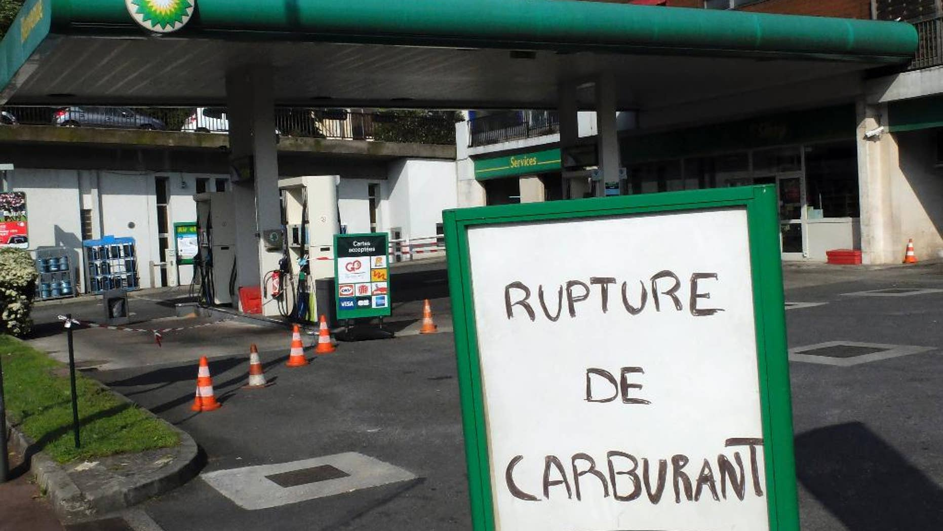 """A poster reads """"Fuel Shortage"""" in a closed gaz station in Sevres, outside Paris, Wednesday, May 25, 2016. France has started using its fuel reserves to deal with gasoline shortages caused by strikes and protests over a bill weakening worker protections. (AP Photo/Bertrand Combaldieu)"""