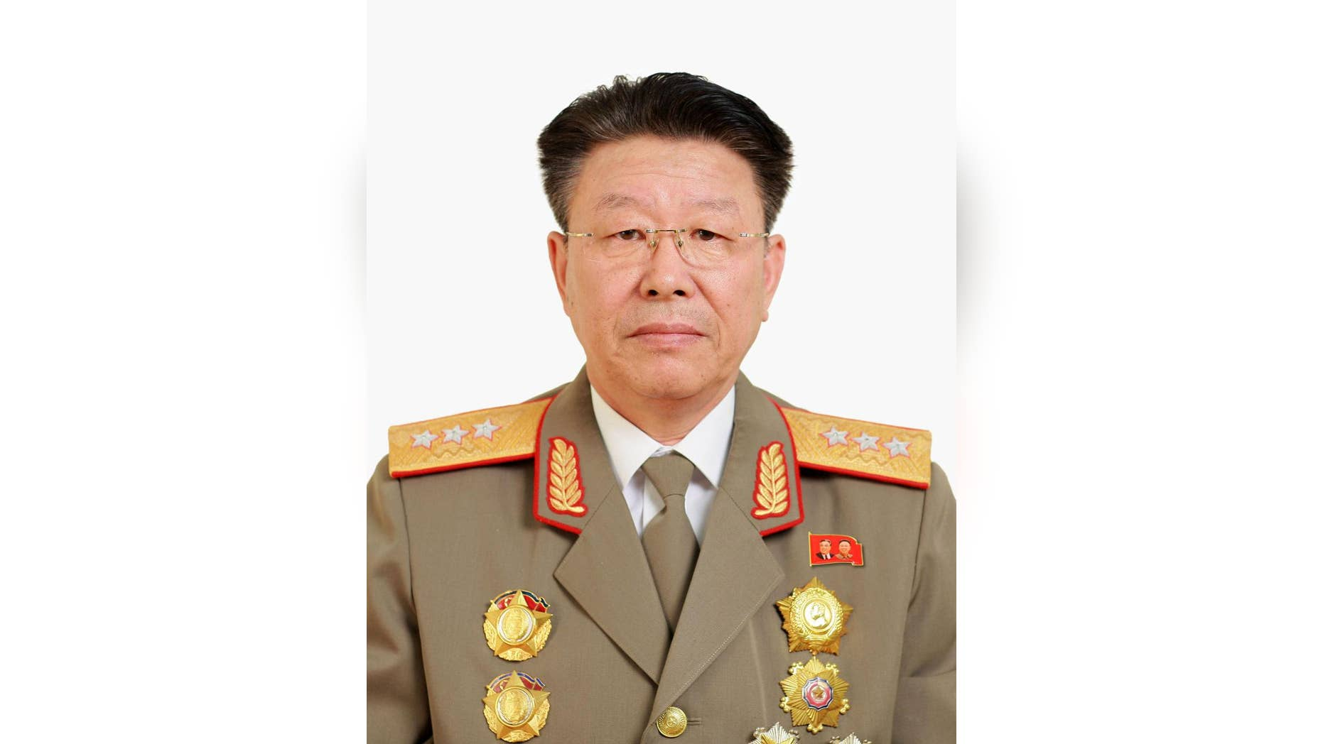 In this photo distributed on Wednesday, May 11, 2016, by the North Korean government, Ri Yong Gil, then North Korean military chief, poses for a photo.  Seoul's intelligence agents get battered in the press and by lawmakers for their gaffes, including one regarding Ri Yong Gil, the former head of North Korea's military. Officials in Seoul's National Intelligence Service, the country's main spy agency, reportedly said Ri had been executed, but at this month's ruling-party congress, he was seen not only alive but also in possession of several new titles.   (Korean Central News Agency/Korea News Service via AP) JAPAN OUT UNTIL 14 DAYS AFTER THE DAY OF TRANSMISSION