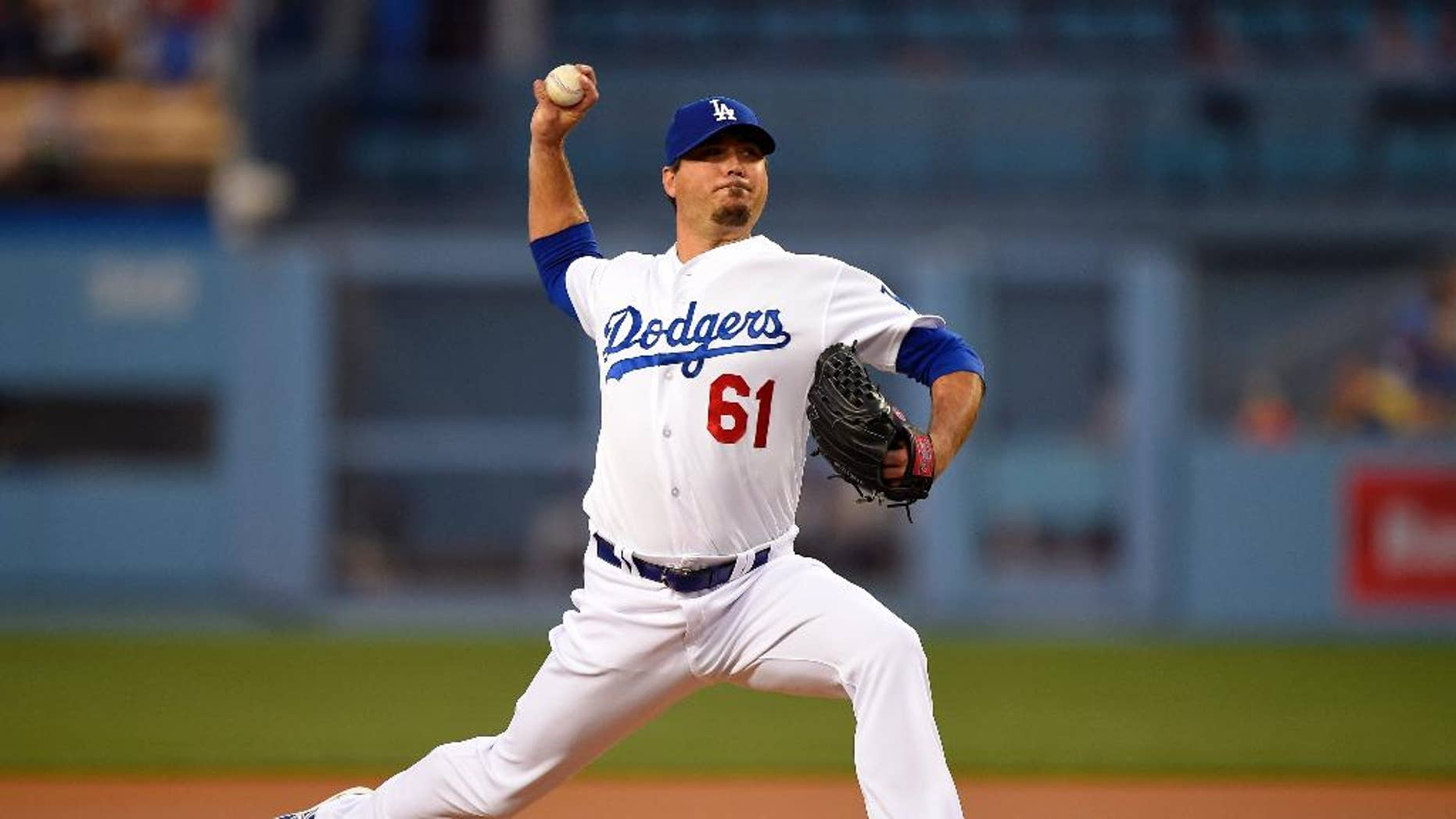 Los Angeles Dodgers starting pitcher Josh Beckett throws to the plate during the first inning of a baseball game against the Detroit Tigers, Wednesday, April 9, 2014, in Los Angeles. (AP Photo/Mark J. Terrill)