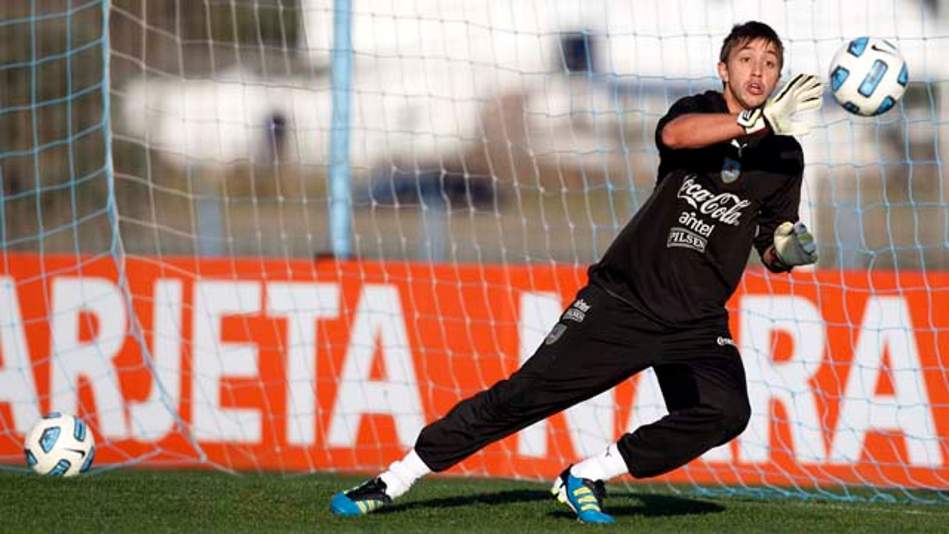 Uruguay's goalkeeper Fernando Muslera attends a training session in Buenos Aires, Argentina, Thursday, July 21, 2011. Uruguay will face Paraguay on July 24 for the final Copa America soccer match. (AP Photo/Natacha Pisarenko)