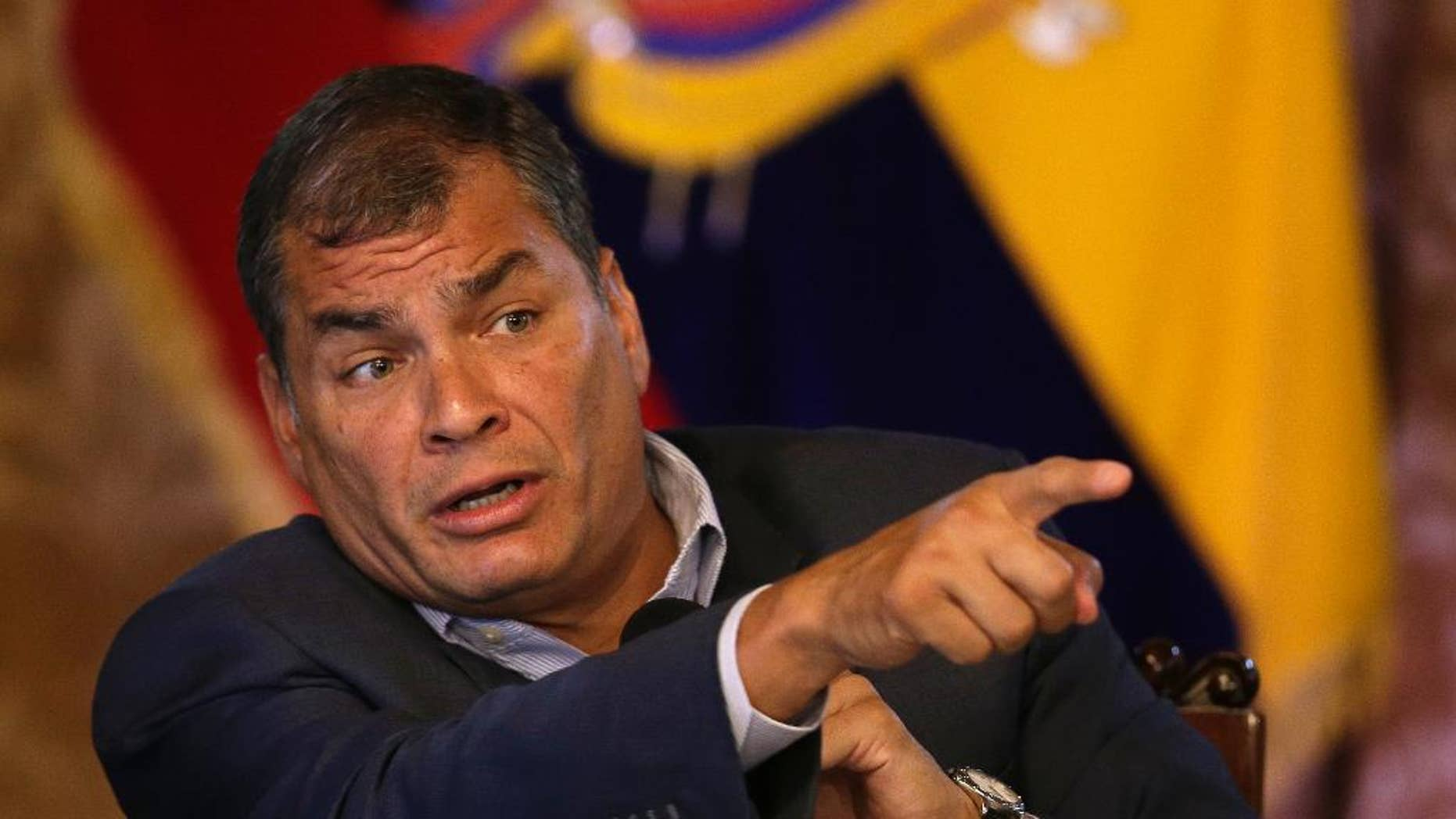 FILE - In this June 8, 2016, file photo, Ecuador's President Rafael Correa points during a press conference in Quito, Ecuador. An Ecuadorean journalist convicted of libeling President Rafael Correa said on Thursday, Aug. 11, that he is broke and must take up a public collection to pay the $141,000 judgment. (AP Photo/Dolores Ochoa, File)