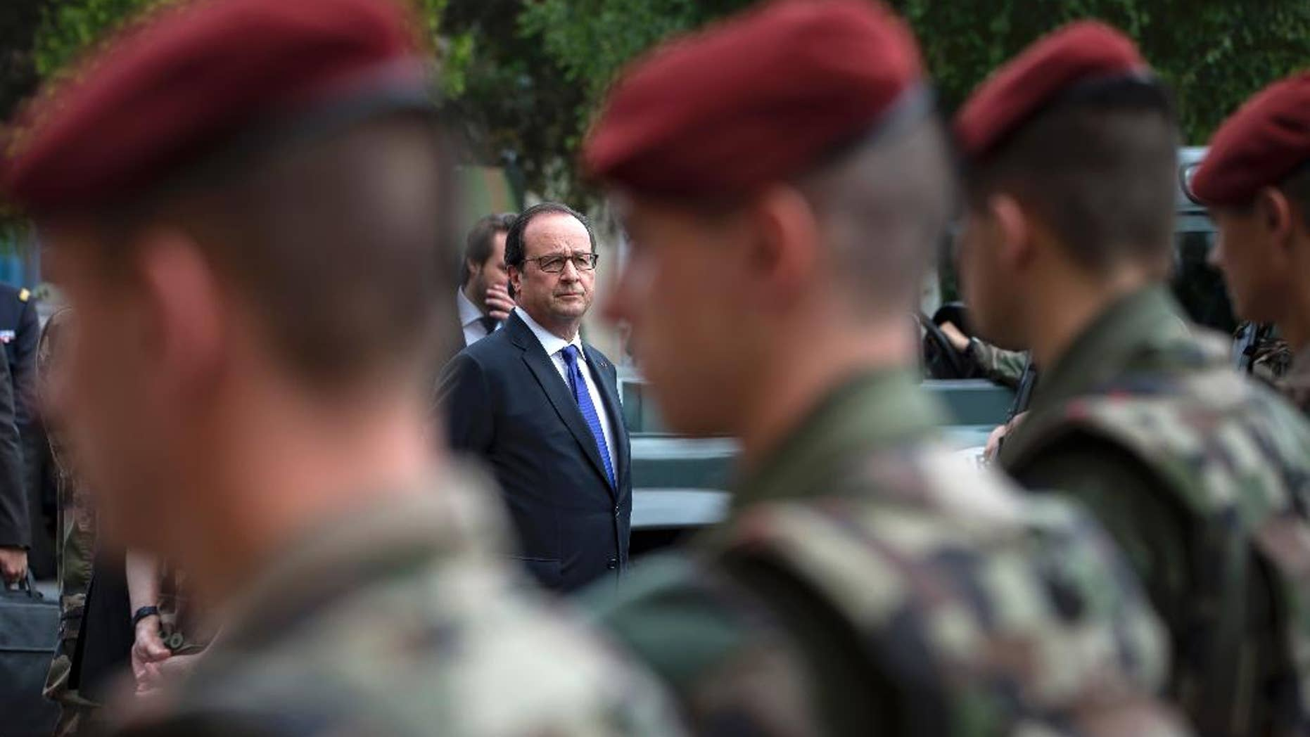 French president Francois Hollande reviews troops at the army base and command center for France's anti-terror 'Vigipirate' plan, dubbed 'Operation Sentinelle', in Vincennes, outside Paris, in July.