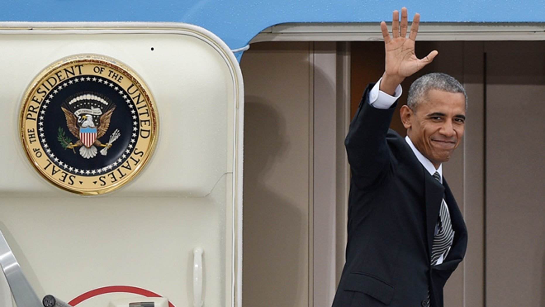 US president Barack Obama  waves as he departs from  Tegel airport in Berlin  Friday Nov. 18, 2016. Obama  met the leaders of key European countries to discuss an array of security and economic challenges facing the trans-Atlantic partners as the U.S. prepares for President-elect Donald Trump to take office in January. (Rainer Jensen/dpa via AP)