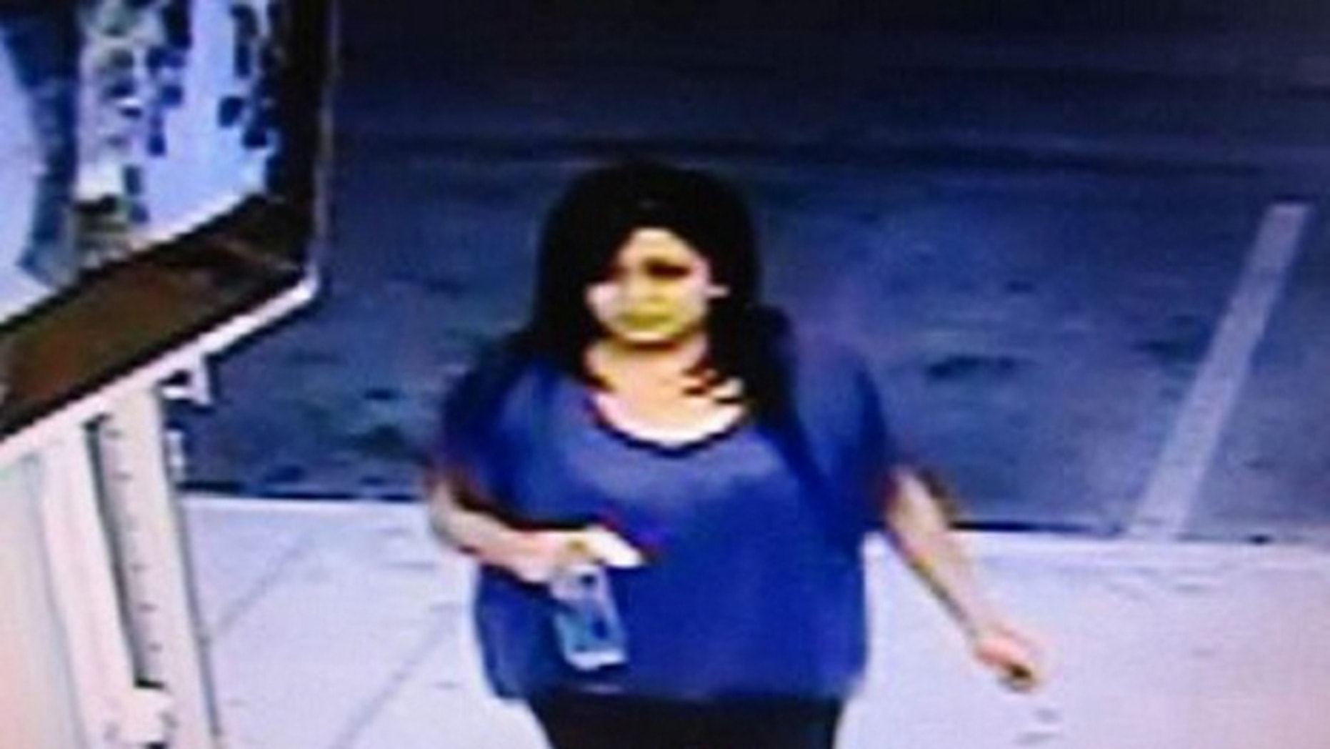 This surveillance image provided by the California Lottery shows a woman they believe won a $23-million jackpot on a SuperLotto Plus ticket she purchased five months ago at an east Palmdale convenience store but she hasn't cashed it yet.