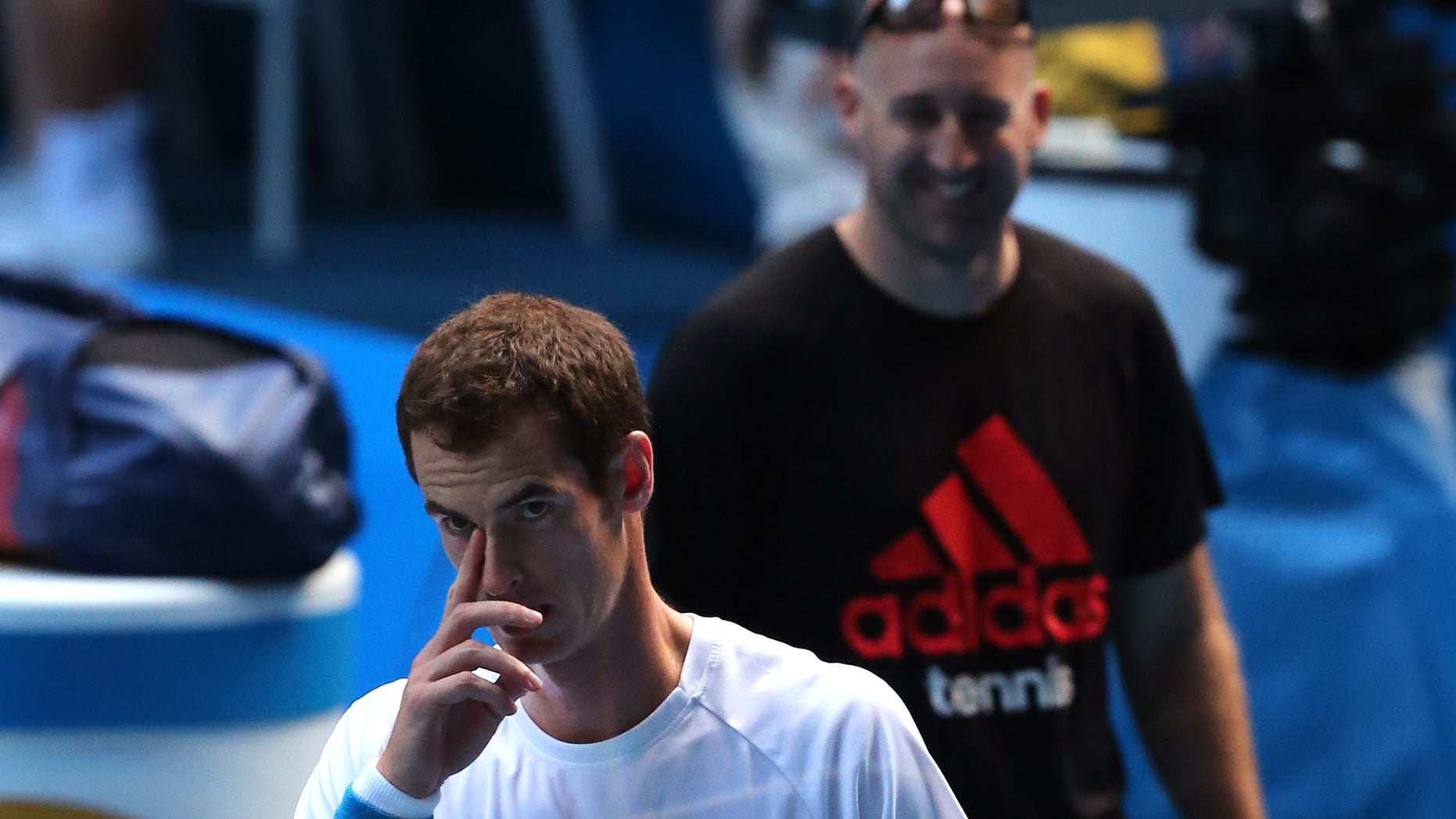 Andy Murray of Britain prepares for a training session on the Rod Laver Arena, at the Australian Open tennis championship in Melbourne, Australia, Tuesday, Jan. 21, 2014.  Wimbledon champion Murray faces Roger Federer, winner of 17 Grand Slams, at the Australian Open quarterfinal Wednesday.(AP Photo/Shuji Kajiyama)