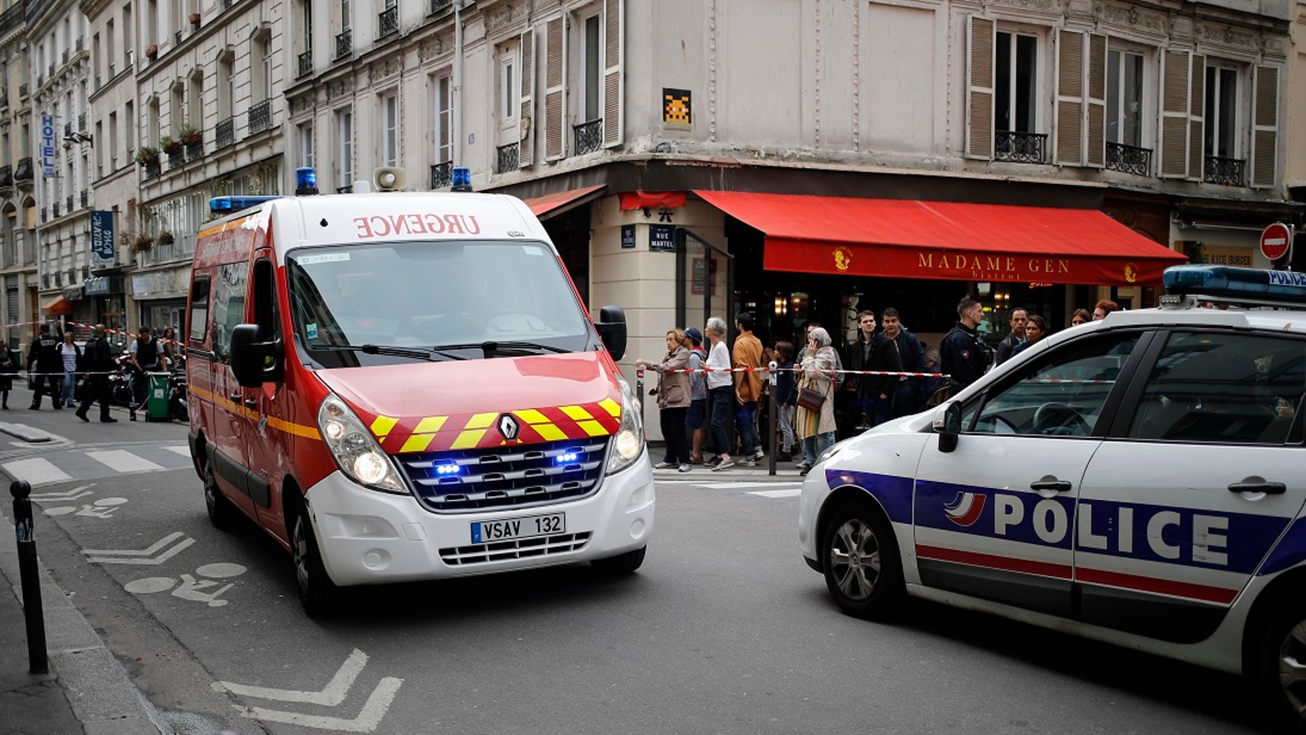 Emergency services arrive at the scene of a hostage situation in central France on Tuesday, June 12, 2018.
