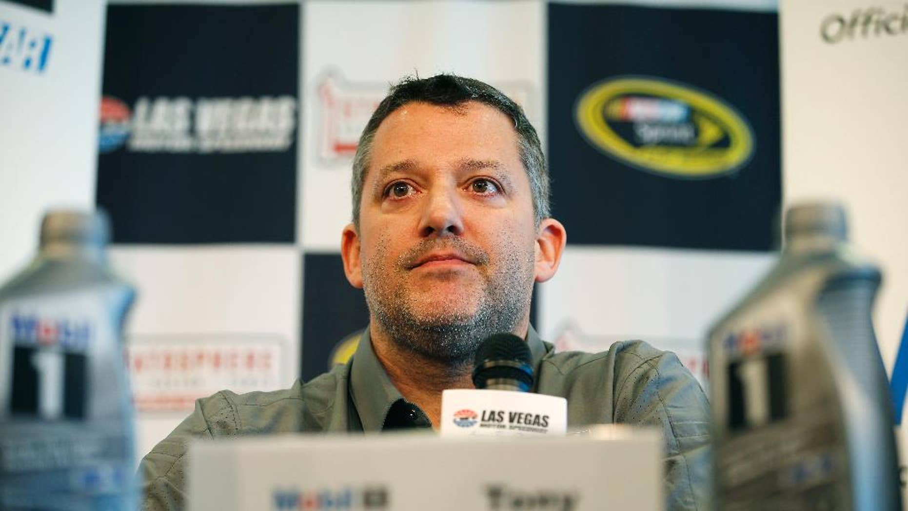 FILE - In this March 4, 2016, file photo, NASCAR driver Tony Stewart speaks during a news conference in Las Vegas. Stewart has been cleared to return to racing and will be back in his car Friday, April 22, 2016, at Richmond International Raceway. The three-time NASCAR champion missed the first eight races of the season with a fractured vertebra suffered in a January all-terrain vehicle accident. (AP Photo/John Locher, File)