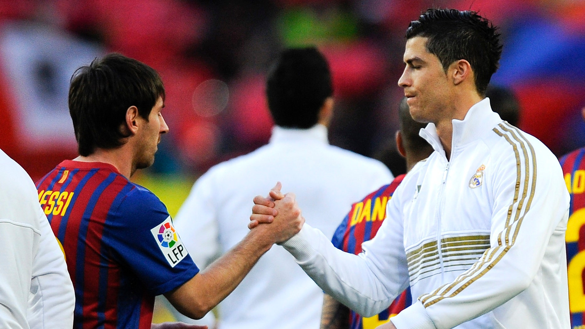 Lionel Messi of FC Barcelona (L) and Cristiano Ronaldo of Real Madrid CF shake hands prior to the La Liga match between FC Barcelona and Real Madrid at Camp Nou on April 21, 2012 in Barcelona, Spain. (Photo by David Ramos/Getty Images)