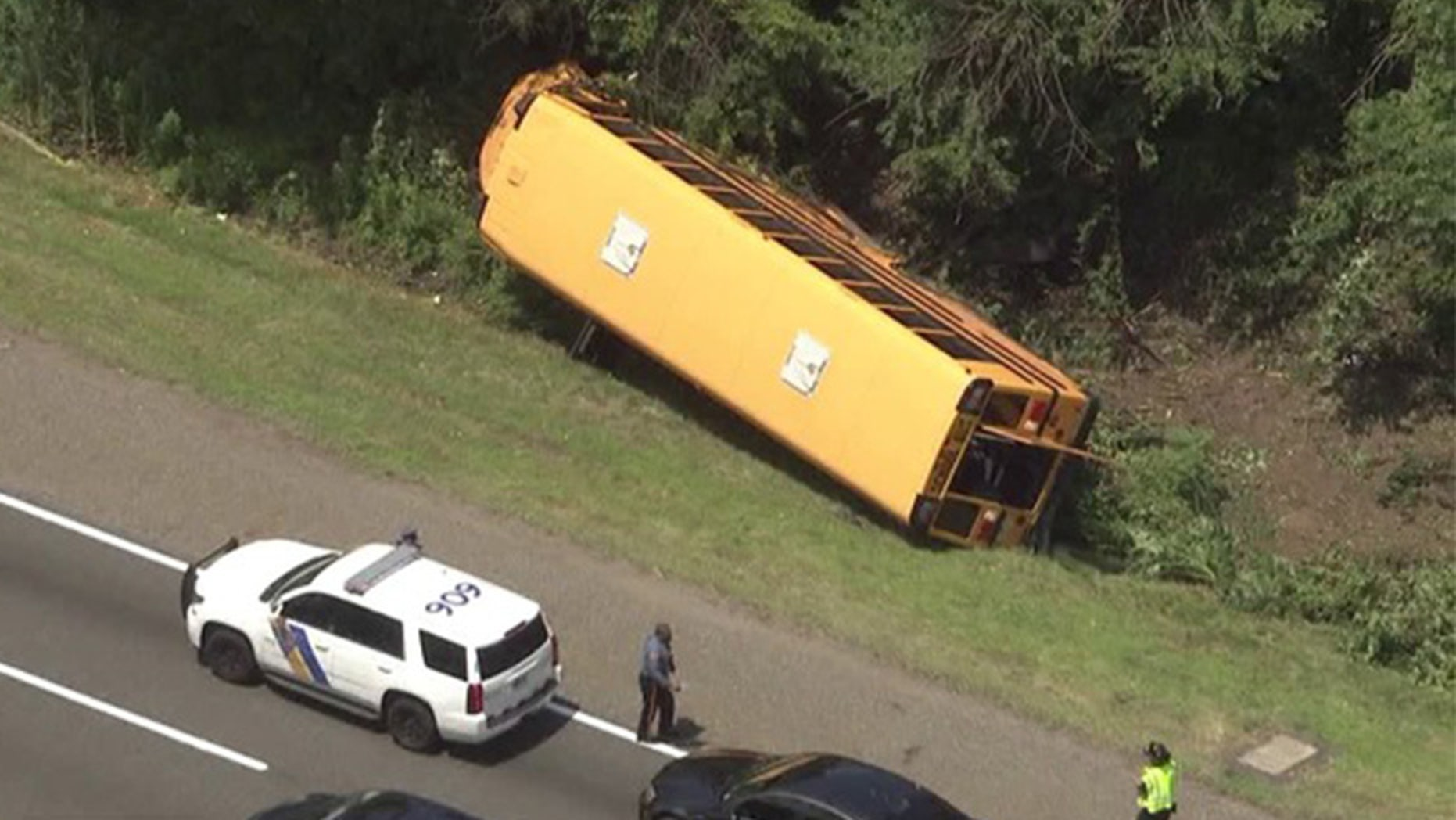 A school bus flipped on its side in Cherry Hill, N.J.