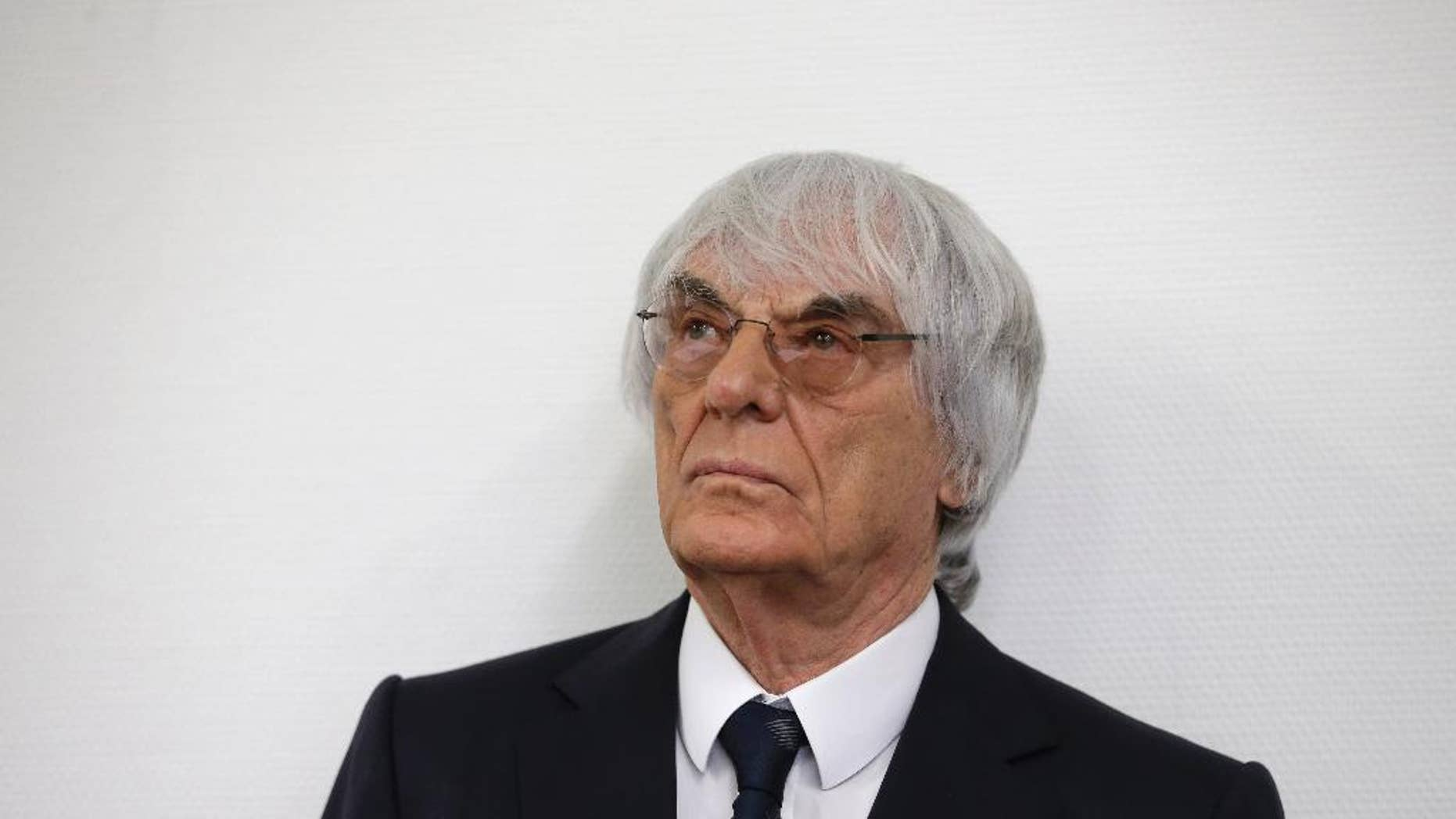 Formula One boss Bernie Ecclestone arrives for his trial in the regional court in Munich, southern Germany, Tuesday, Aug.5, 2014. German prosecutors said Tuesday that they will accept dropping the bribery case against Ecclestone in exchange for a US dollar 100 million payment by the Formula One boss, and judges were considering whether to close his trial. Ecclestone went on trial at the Munich state court in late April on charges of bribery and incitement to breach of trust — which could, if he were convicted, carry a sentence of up to 10 years in prison. (AP Photo/Matthias Schrader)