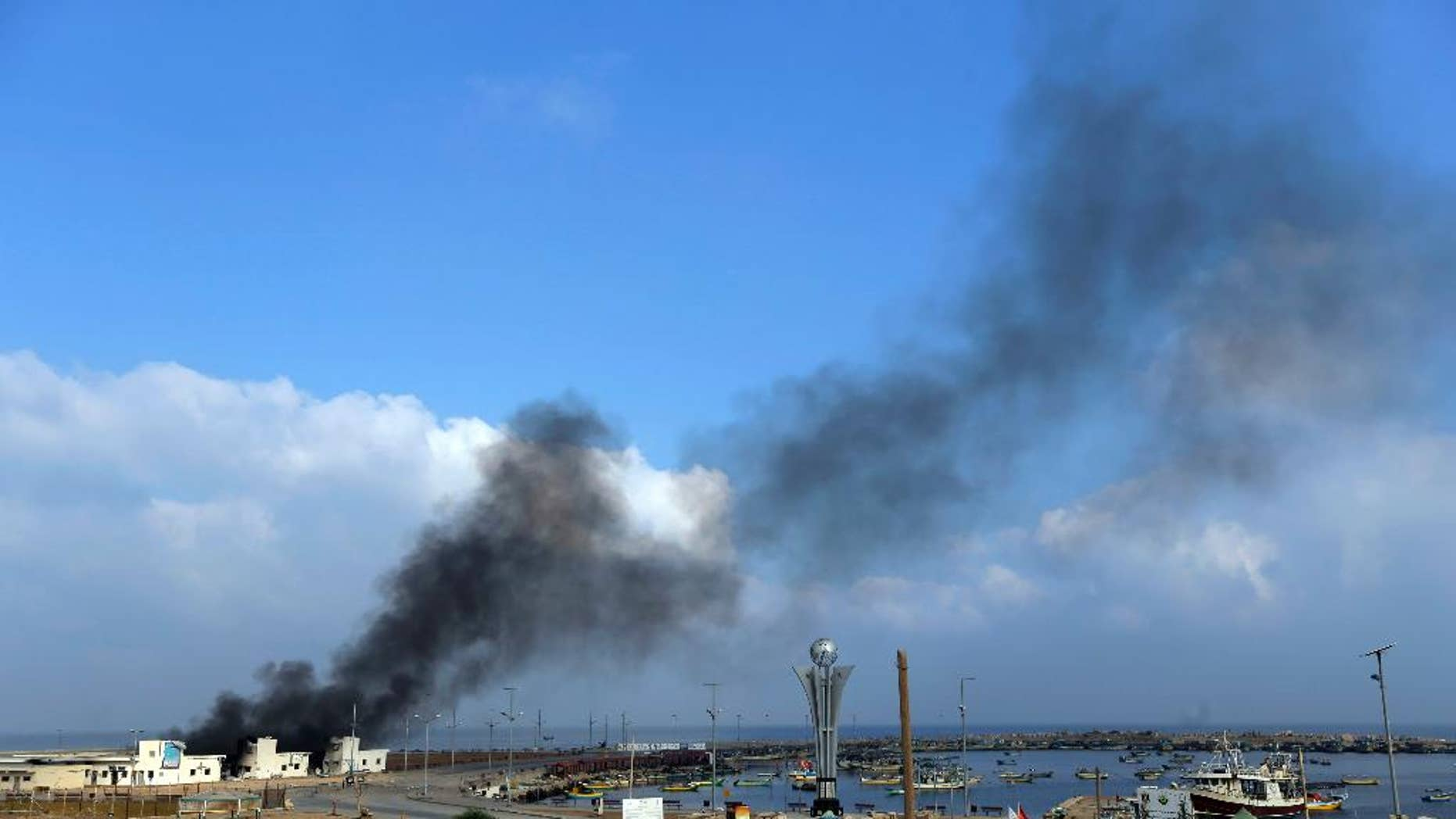Smoke rises at the port in Gaza City, northern Gaza Strip, hit by an Israeli strike, Tuesday, July 29, 2014. According to Palestinians, the storage area at the port where the fishermen keep their nets and equipment was hit. Early Tuesday, Israel warplanes struck a series of targets in Gaza City, including Hamas leader Ismael Haniyeh's house and government offices, while Gaza's border area with Israel was hit by heavy tank shelling. (AP Photo/Lefteris Pitarakis)