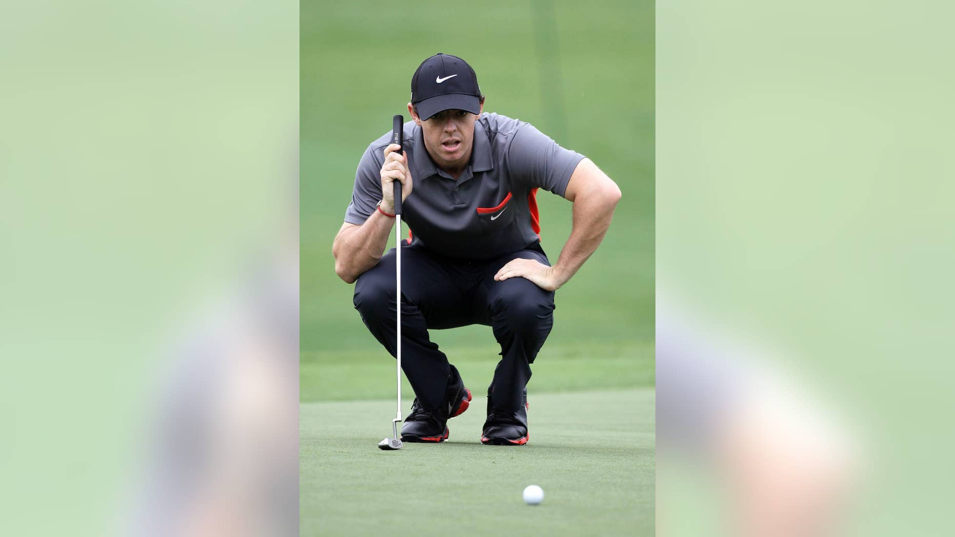 Rory McIlroy eyes his putt on the 18th green during the pro-am of the Wells Fargo Championship golf tournament at Quail Hollow Club in Charlotte, N.C., Wednesday, April 30, 2014. (AP Photo/Bob Leverone)
