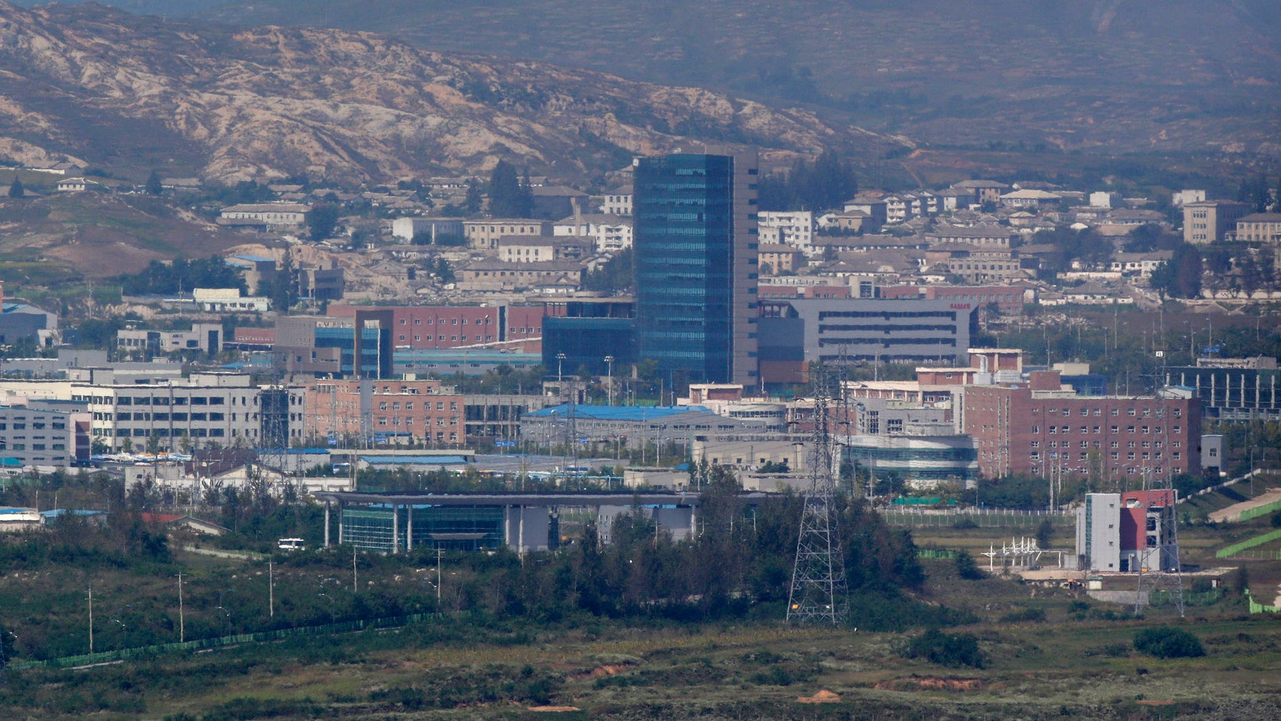FILE - This Sept. 25, 2013 file photo shows the Kaesong industrial complex, whish is seen from the Dora Observation Post in Paju near the border village of Panmunjom, which has separated the two Koreas since the Korean War, in Paju, north of Seoul, South Korea. South Korean lawmakers will tour the jointly-run factory park in North Korea next week, officials said Thursday, Oct. 24, 2013. Pyongyang approved the visit next Wednesday by 24 National Assembly members and their aides, Ministry of Unification spokeswoman Park Sujin said. (AP Photo/Lee Jin-man, File)