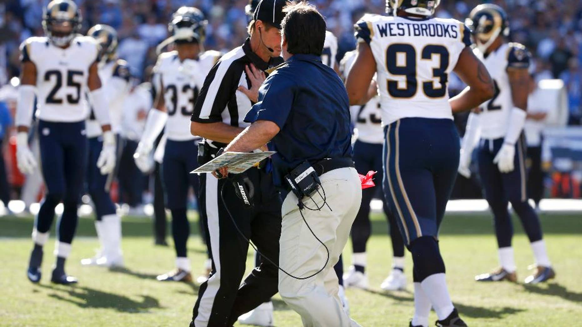 St. Louis Rams head coach Jeff Fisher puts his hand on a referee during the first half of an NFL football game against the San Diego Chargers, Sunday, Nov. 23, 2014, in San Diego. (AP Photo/Lenny Ignelzi)