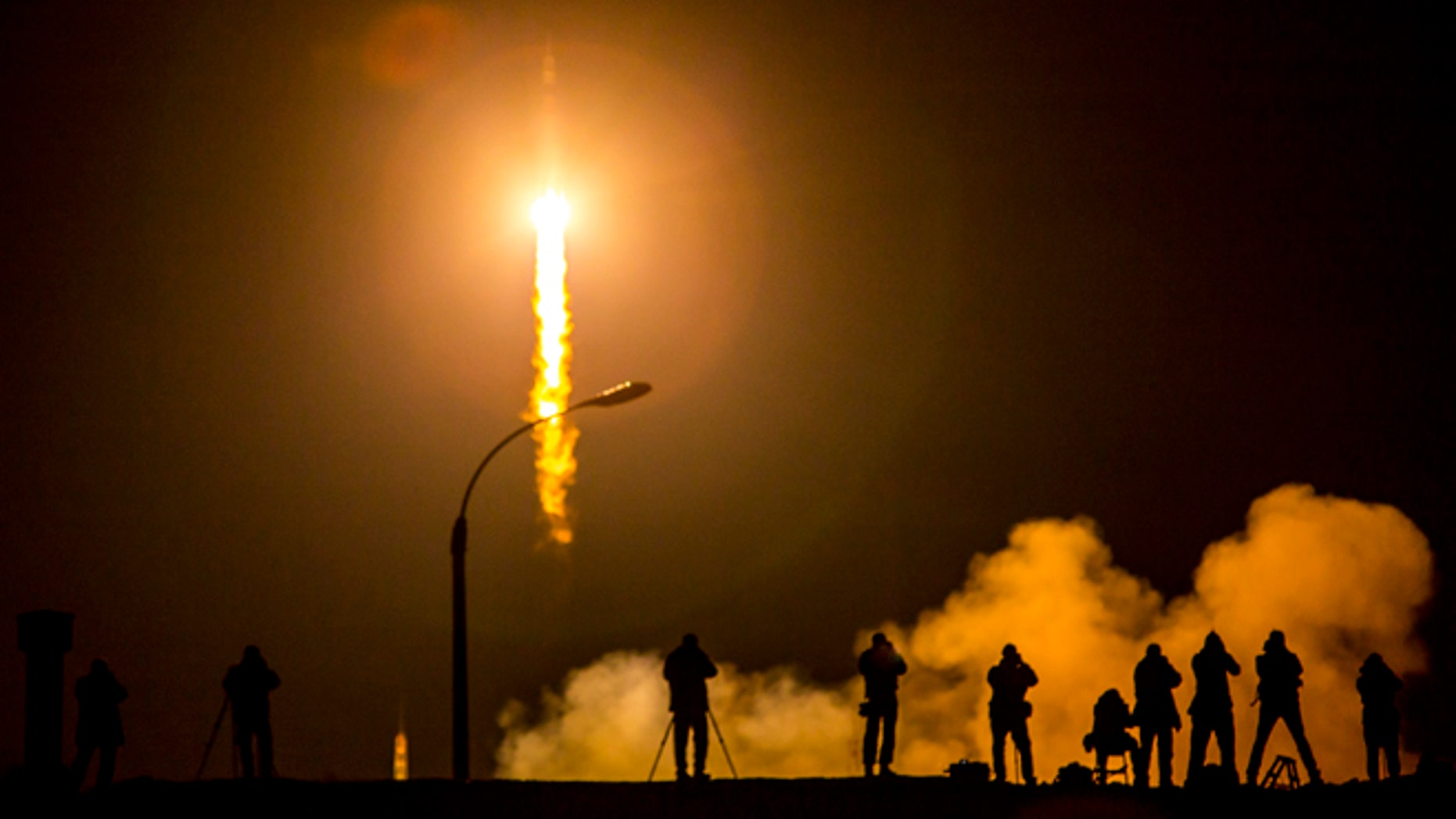 BAIKONUR, KAZAKHSTAN - MARCH 28: In this handout provided by NASA, The Soyuz TMA-16M spacecraft is seen as it launches to the International Space Station with Expedition 43 NASA Astronaut Scott Kelly, Russian Cosmonauts Mikhail Kornienko, and Gennady Padalka of the Russian Federal Space Agency (Roscosmos) onboard Saturday, March 28, 2015, Kazakh time (March 27 Eastern time) from the Baikonur Cosmodrome in Kazakhstan. As the one-year crew, Kelly and Kornienko will return to Earth on Soyuz TMA-18M in March 2016.   (Photo by Bill Ingalls/NASA via Getty Images)