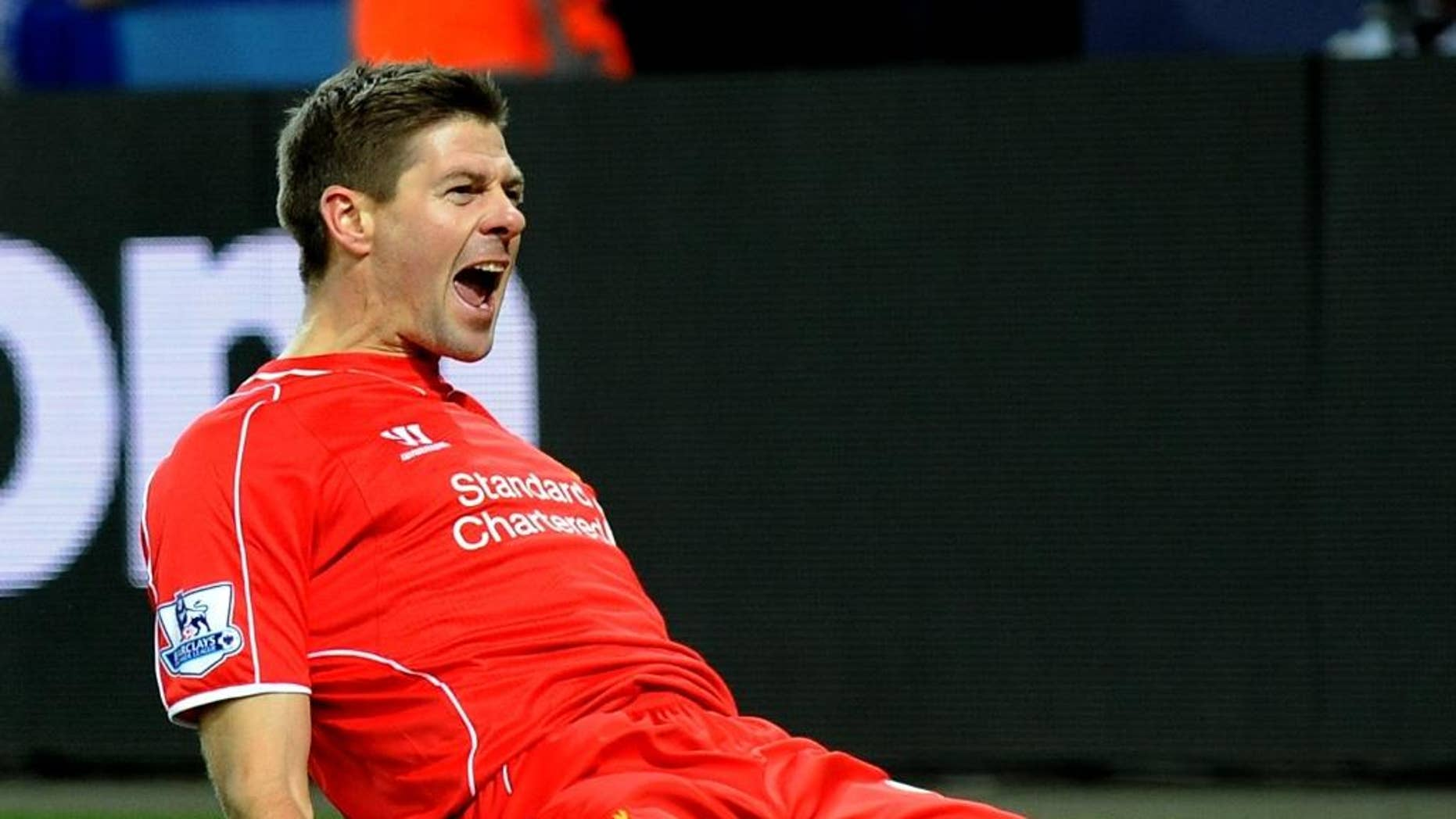 """FILE - In this Liverpool's Tuesday, Dec. 2, 2014 file photo, Steven Gerrard celebrates scoring against Leicester during the English Premier League soccer match between Leicester City and Liverpool at King Power Stadium, in Leicester, England. Gerrard, the former Liverpool and England captain, announced his retirement from professional soccer on Thursday, Nov. 24, 2016 and said he is considering a """"number of options"""" about his next career move. (AP Photo/Rui Vieira, File)"""
