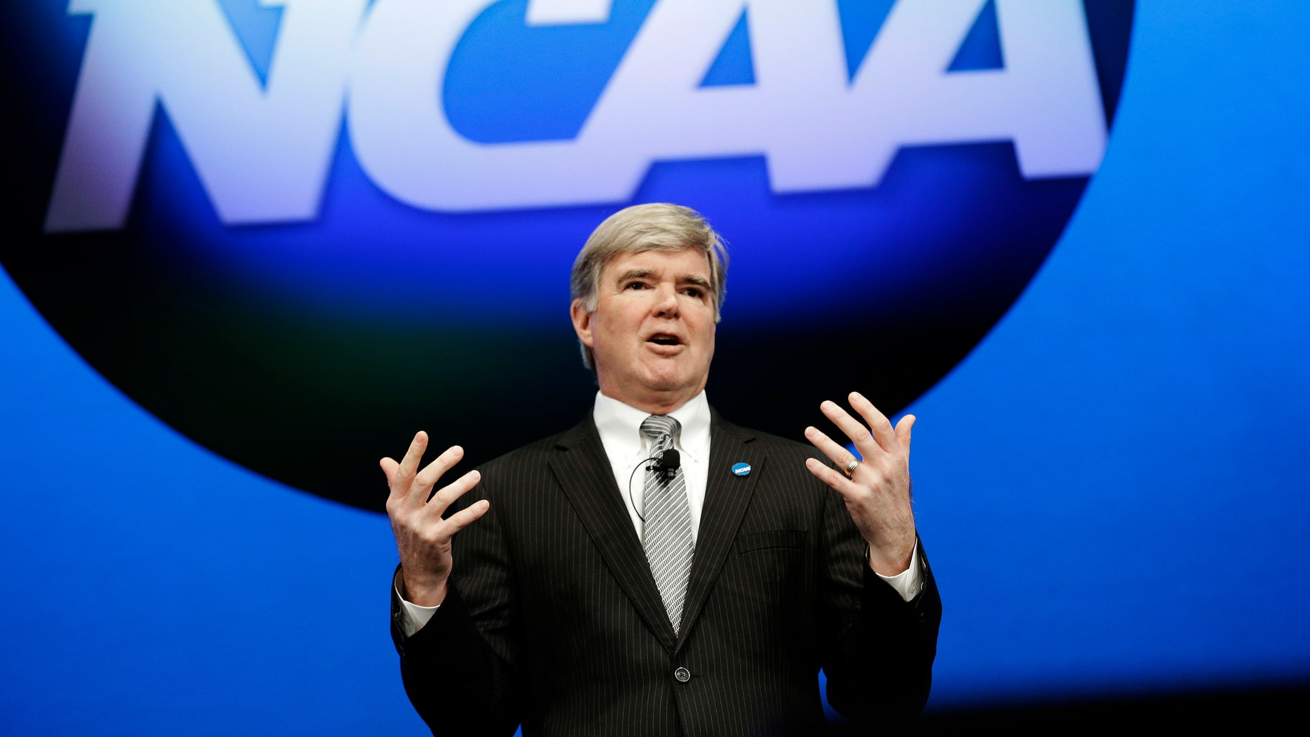 """FILE - In this Jan. 17, 2013, file photo, NCAA President Mark Emmert speaks at the organization's annual convention in Grapevine, Texas. The NCAA is revealing that it has found """"an issue of improper conduct"""" within its own enforcement program during its investigation into the compliance practices of Miami's athletic department.  Emmert has ordered an external review of the enforcement program. Miami will not receive its notice of allegations until that review is complete. (AP Photo/LM Otero, File)"""