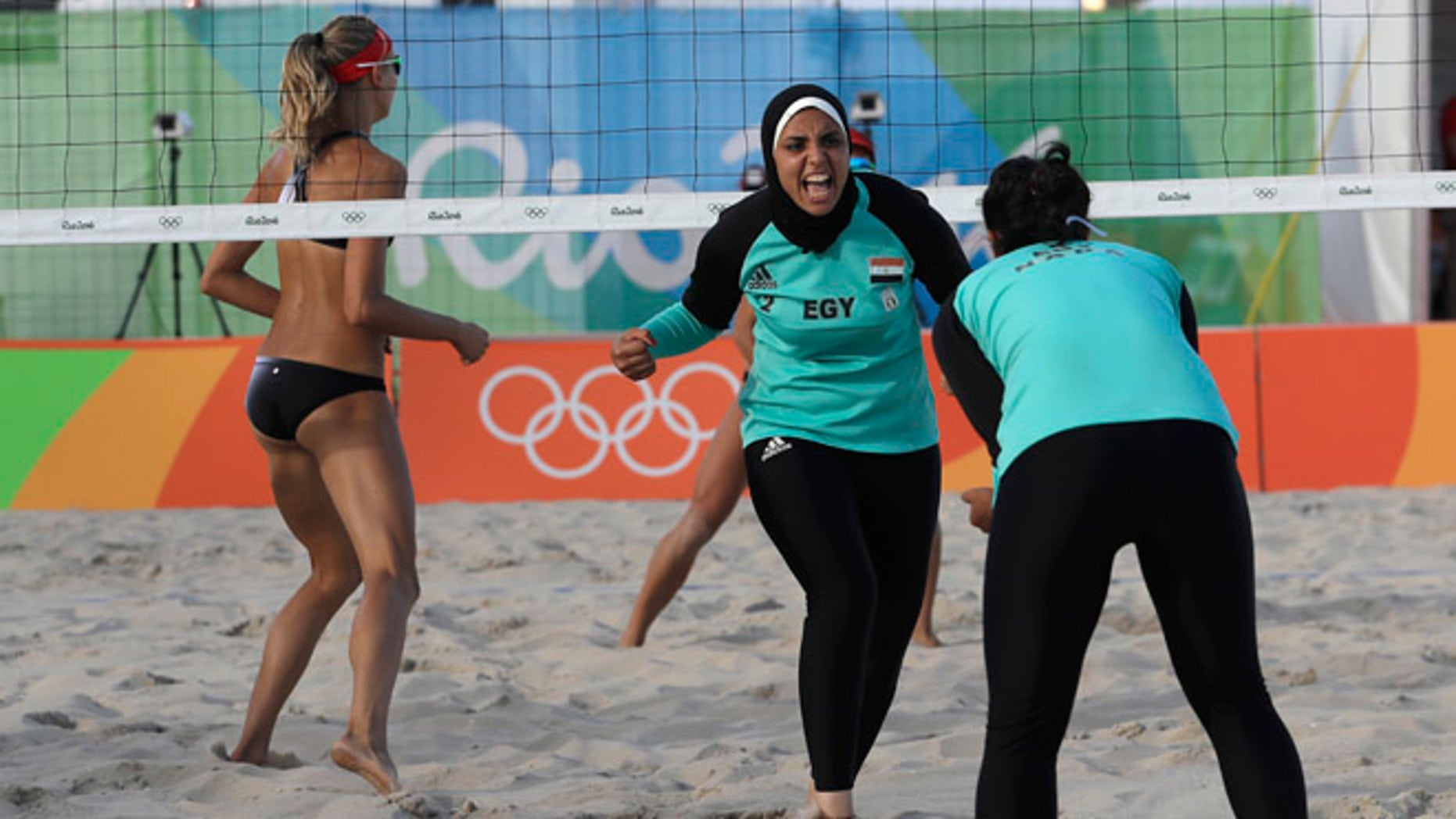 Aug. 11, 2016: Egypt's Doaa Elghobashy, center, celebrates a point with teammate Nada Meawad against Canada during a women's beach volleyball match at the 2016 Summer Olympics in Rio de Janeiro, Brazil.