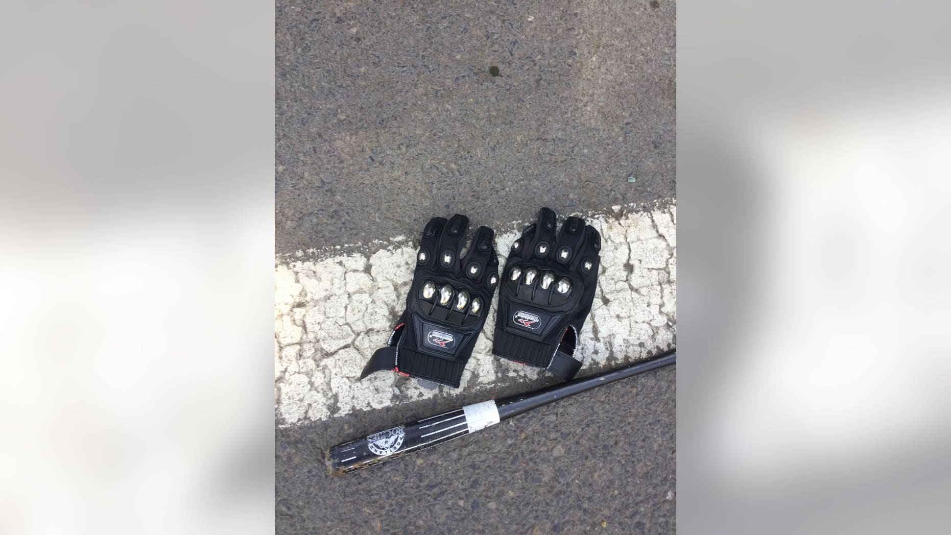 Police confiscated items such as gloves and a bat before allowing demonstrators to rally in Portland Sunday.