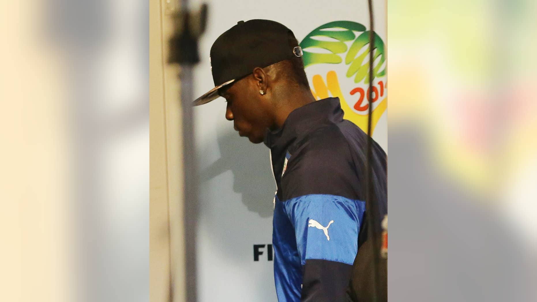 Italy forward Mario Balotelli walks away after the group D World Cup soccer match between Italy and Uruguay at the Arena das Dunas in Natal, Brazil, Tuesday, June 24, 2014. Uruguay won 1-0. Uruguay won 1-0. The four-time champion Italy is heading home after the group phase for a second time in four years. Head coach Cesare Prandelli and football federation president Giancarlo Abete both resigned moments after the match. (AP Photo/Antonio Calanni)