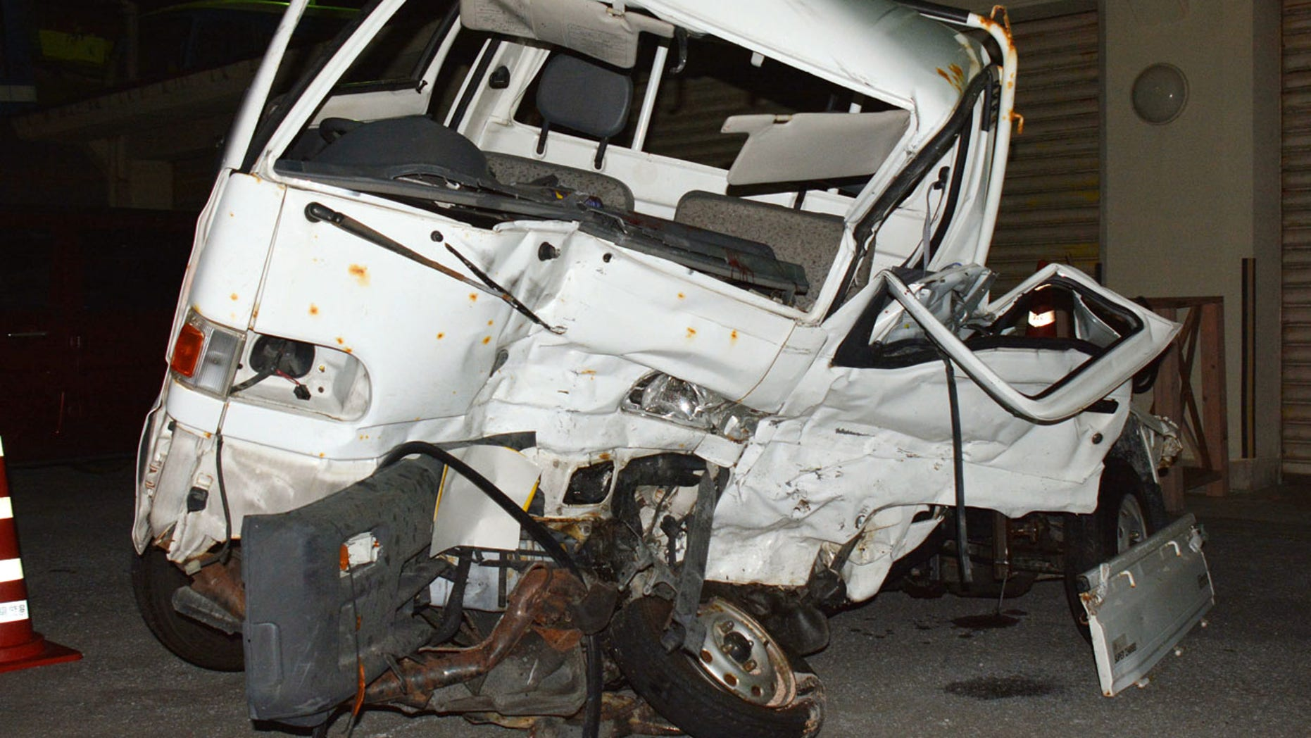 Nov. 19: A Japanese driver's damaged vehicle is placed at a police station in Naha, Okinawa.