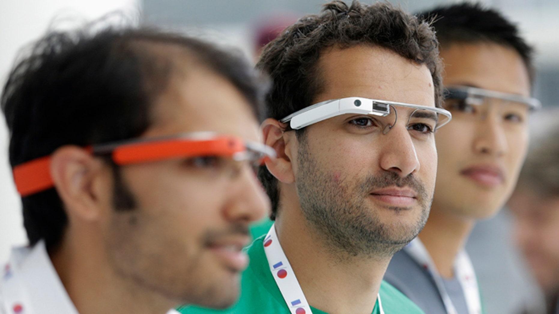 May 15, 2013: Google Glass team members wear Google Glasses at a booth at Google I/O 2013 in San Francisco.