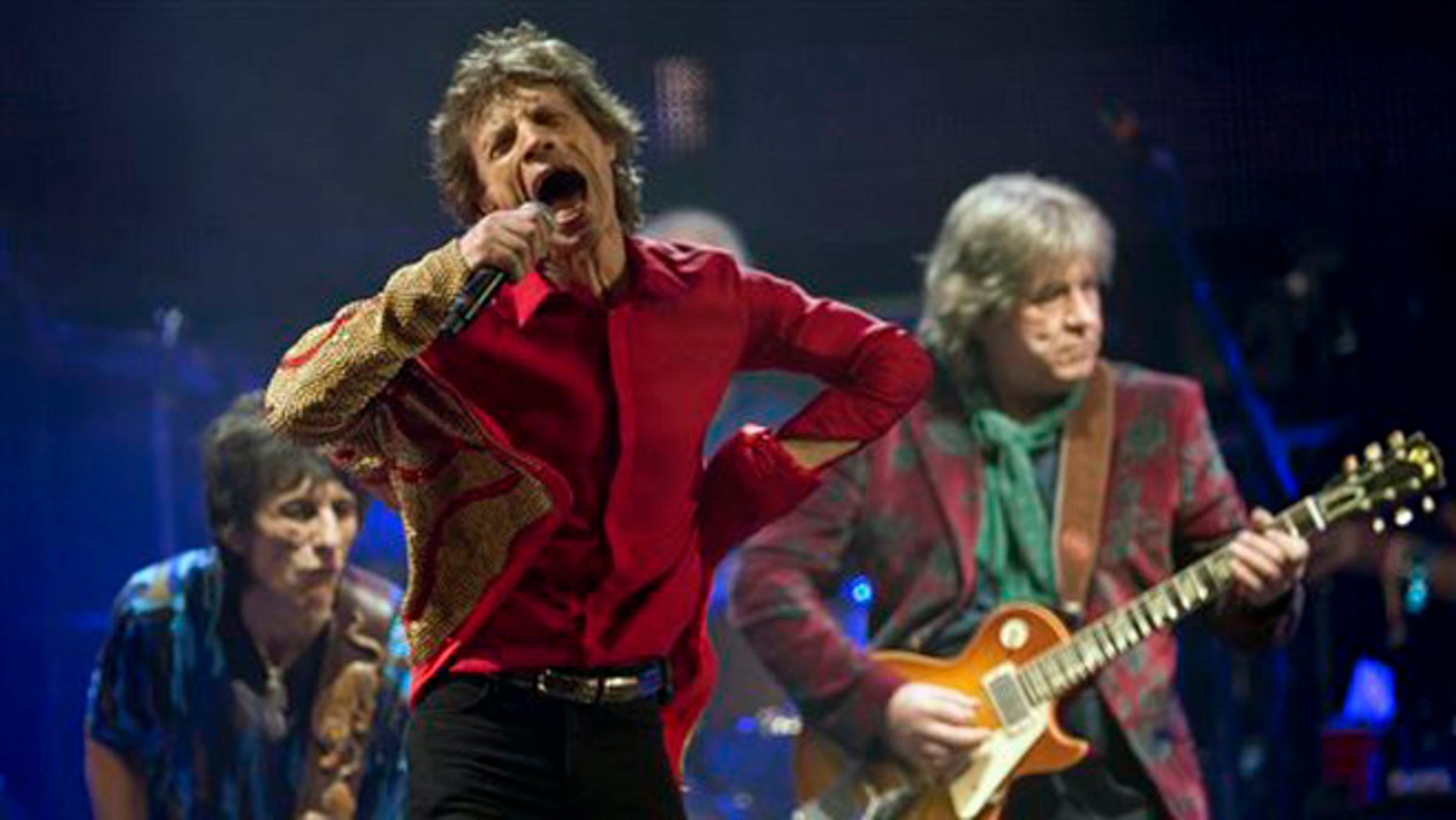 FILE - In this June 29, 2013 file photo Mick Jagger, center, Ronnie Wood, left, and Mick Taylor, of British rock band The Rolling Stones, perform on the Pyramid main stage at Glastonbury, England. The Rolling Stones on Tuesday, Nov. 19, 2013 announced they'll be playing a gig March 22, 2014 at the Adelaide Oval in Australia. The band hasn't played the country since 2006. A news release says former member Taylor will be a special guest for the concert. (Photo by Joel Ryan/Invision/AP, File)