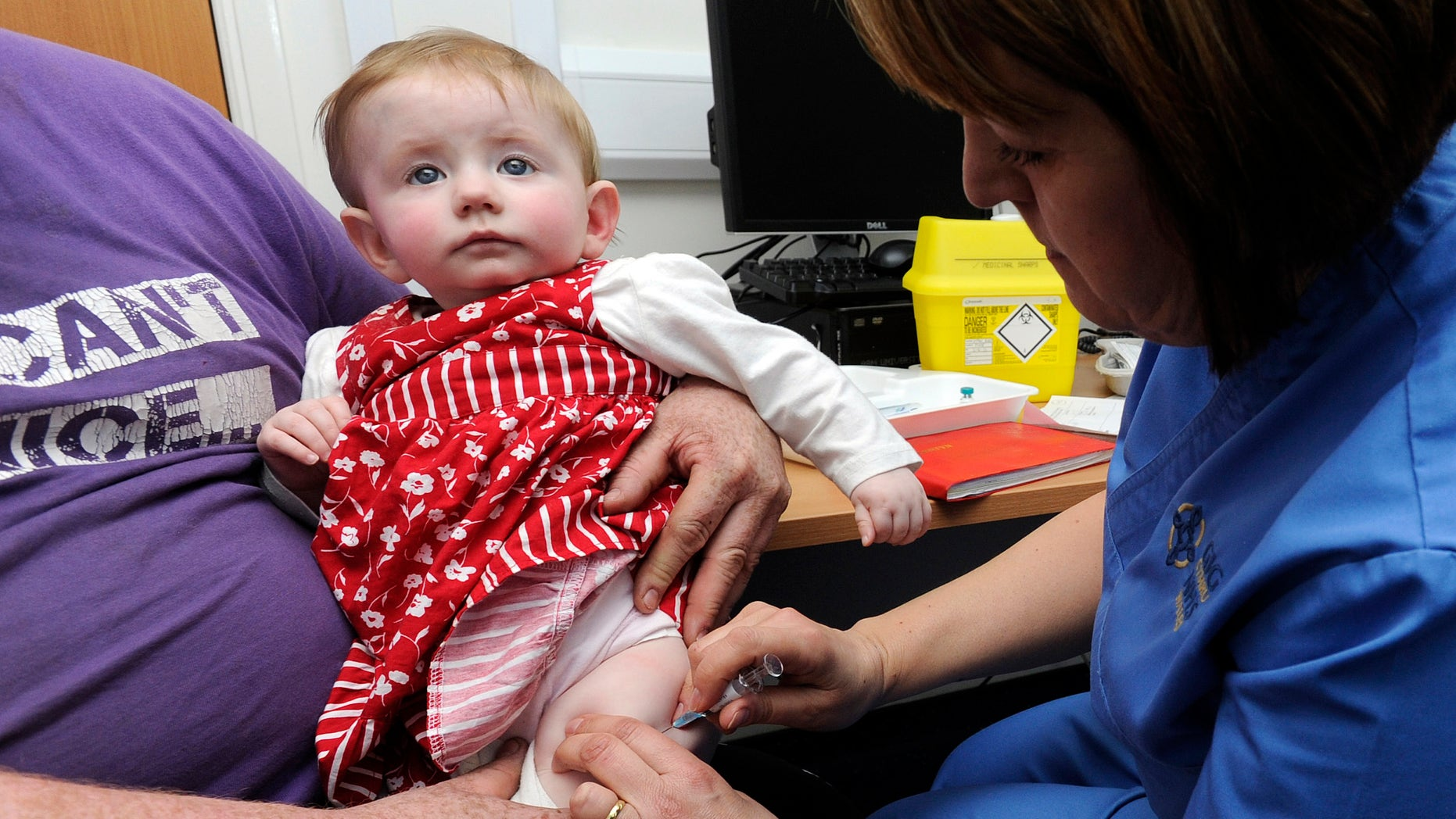 A 10-month-old receives an MMR injection. (REUTERS/Rebecca Naden)