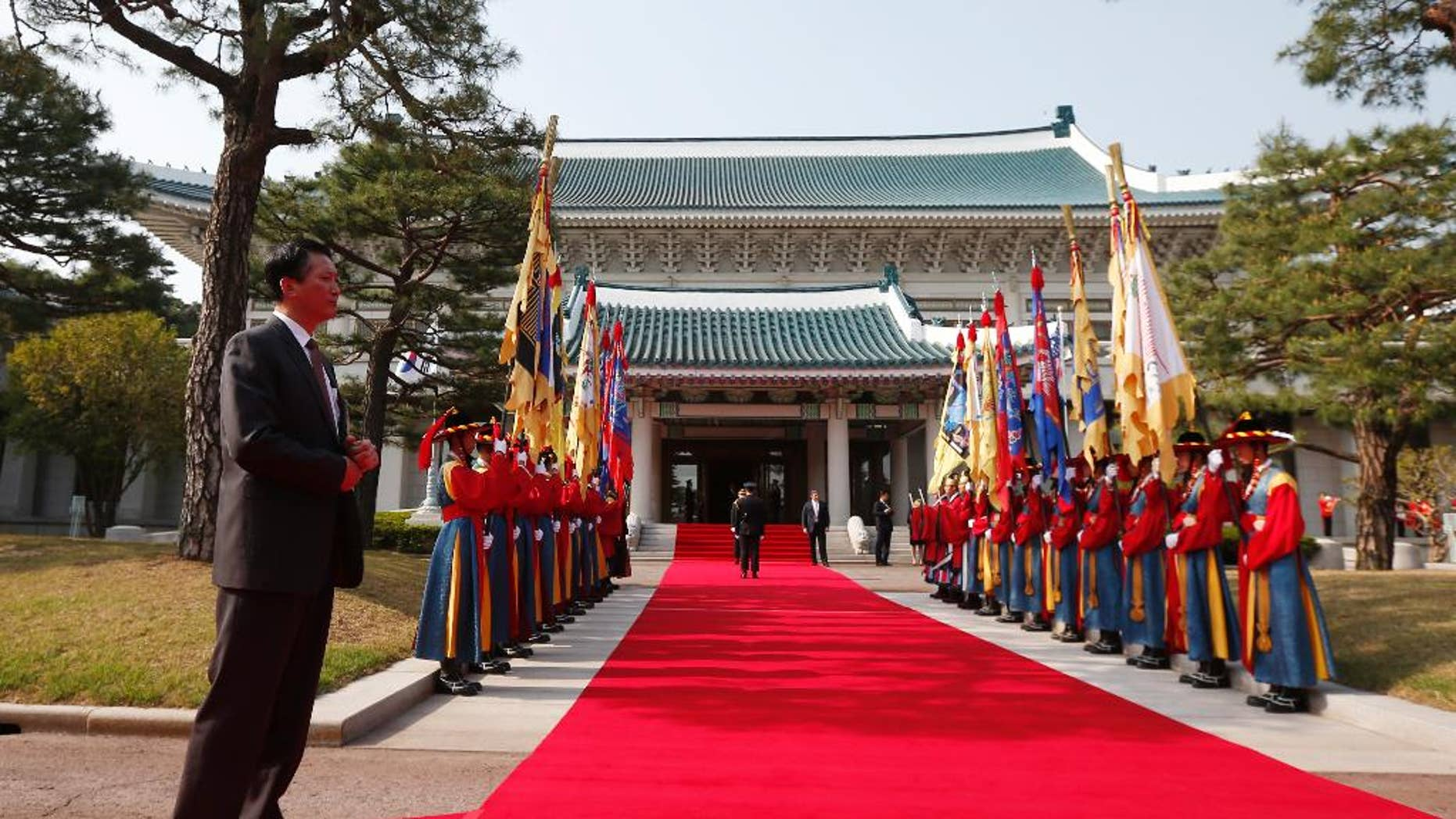 In this April 25, 2014, photo, a security official stands at the Blue House in Seoul, South Korea, before an official welcoming ceremony. South Korea said Wednesday, April 27, 2016, that North Korea has built a half-size mock-up of the South's presidential palace at a firing range in what looked like preparations for a live-fire drill. (AP Photo/Charles Dharapak)
