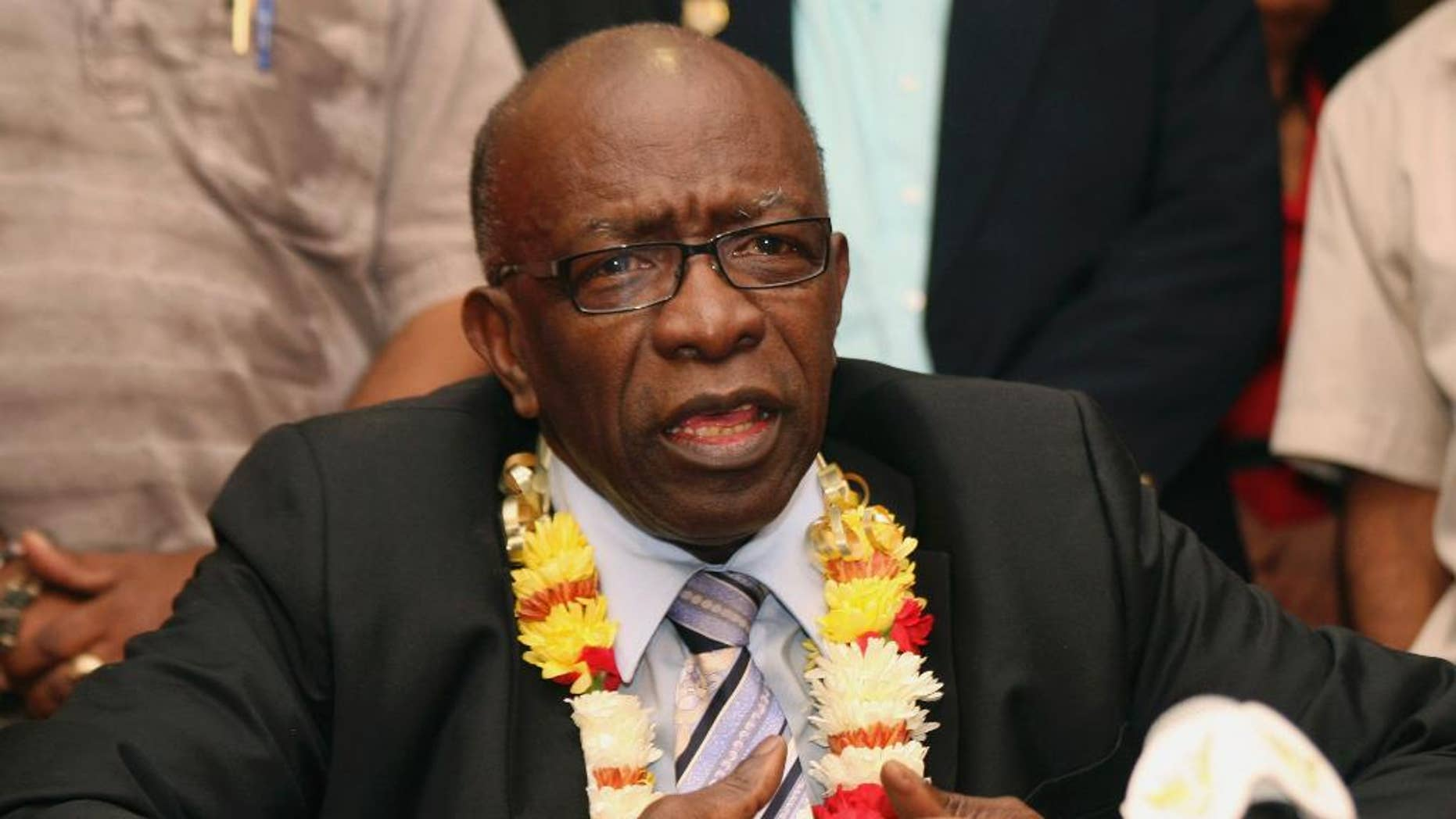 FILE - In this Thursday, June 2, 2011 file photo, suspended FIFA executive Jack Warner gestures during a news conference held shortly after his arrival at the airport in Port-of-Spain, in his native Trinidad and Tobago. Warner was one of the 14 people indicted Wednesday May 27, 2015 in the U.S. on corruption charges.  (AP Photo/Shirley Bahadur, File)