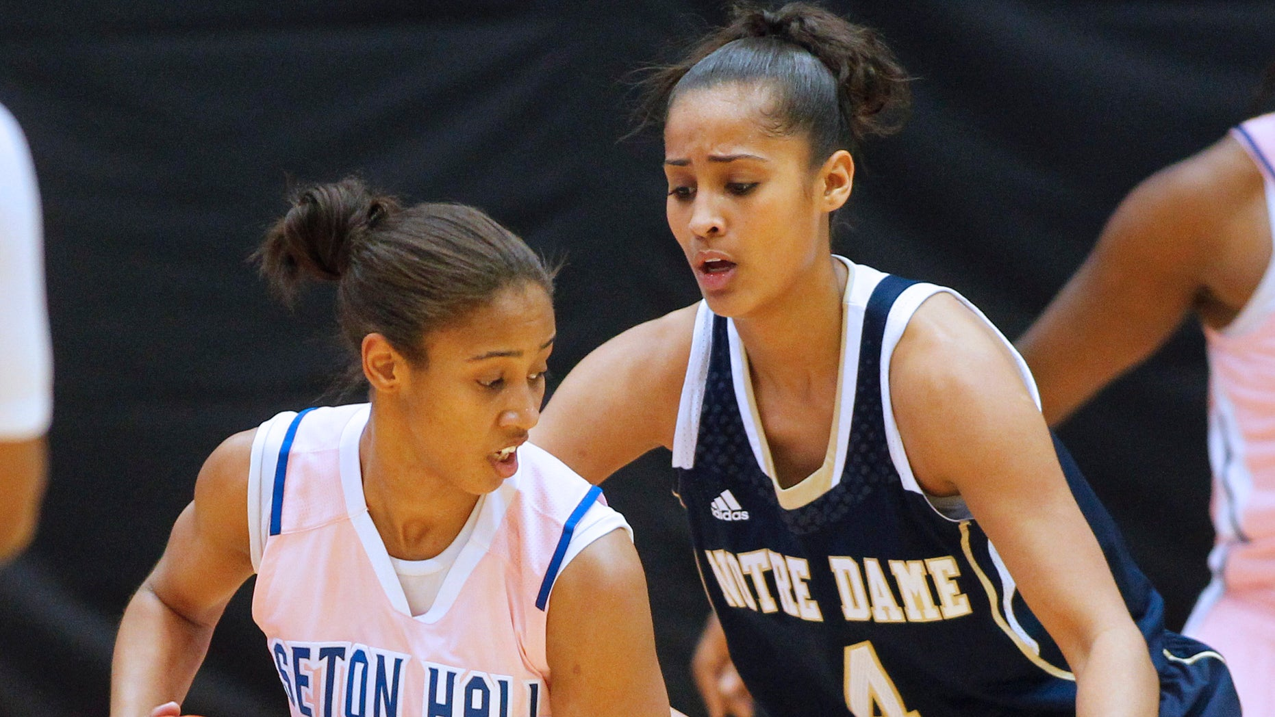 Seton Hall's Brittany Morris (2) attempts to get past Notre Dame's Skylar Diggins (4) during the second half of an NCAA college basketball game in South Orange, N.J. Saturday, Feb. 9, 2013. Notre Dame defeated Seton Hall 69-50. (AP Photo/Rich Schultz)