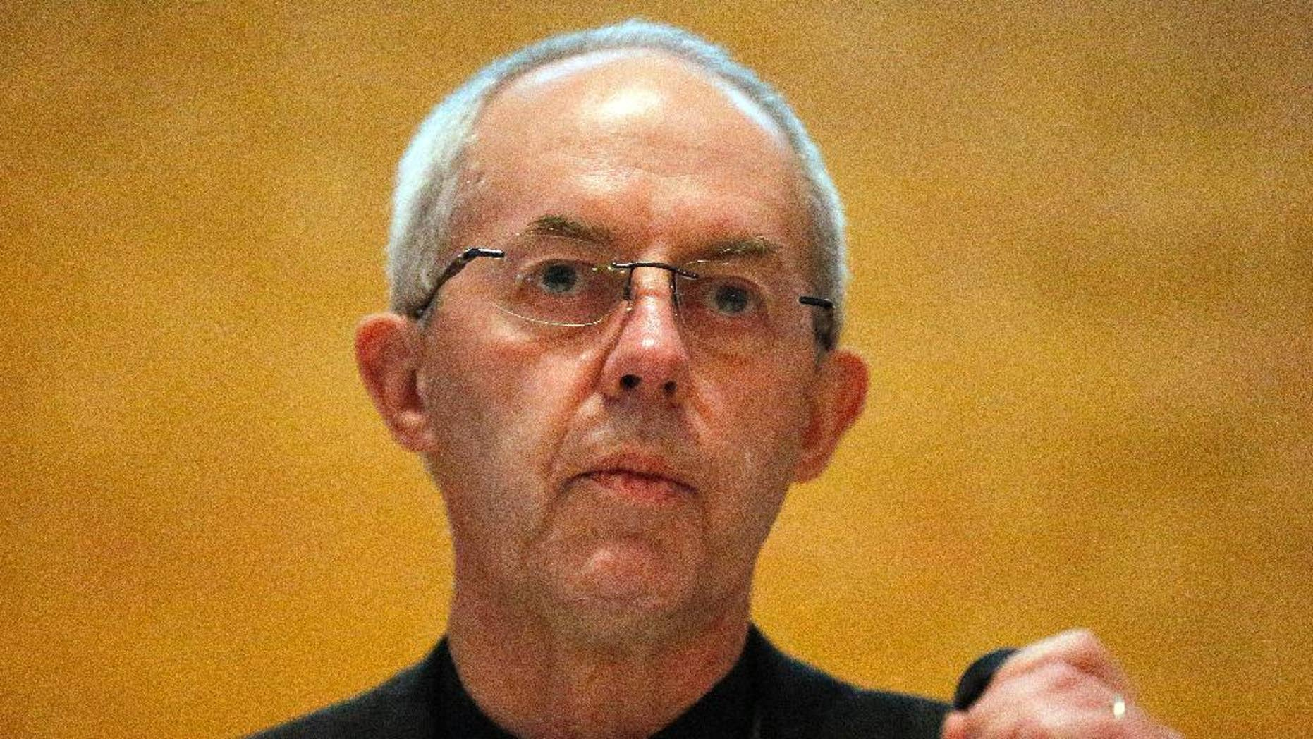 FILE- In this Friday, Jan. 15, 2016 file photo, the Archbishop of Canterbury, Justin Welby, addresses the media during a press conference in Canterbury, England. The archbishop of Canterbury said, Saturday, April 9, 2016, DNA tests have identified his real father, but the revelation hasn't shaken his sense of identity. (AP Photo/Frank Augstein, File)