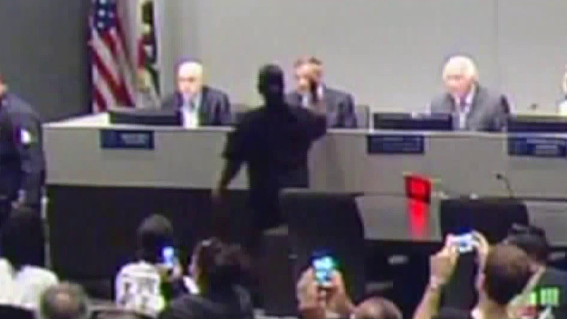 Footage of the LAPD commission meeting appears to show Sheila Hines-Brim throw ashes at Chief Charlie Beck.
