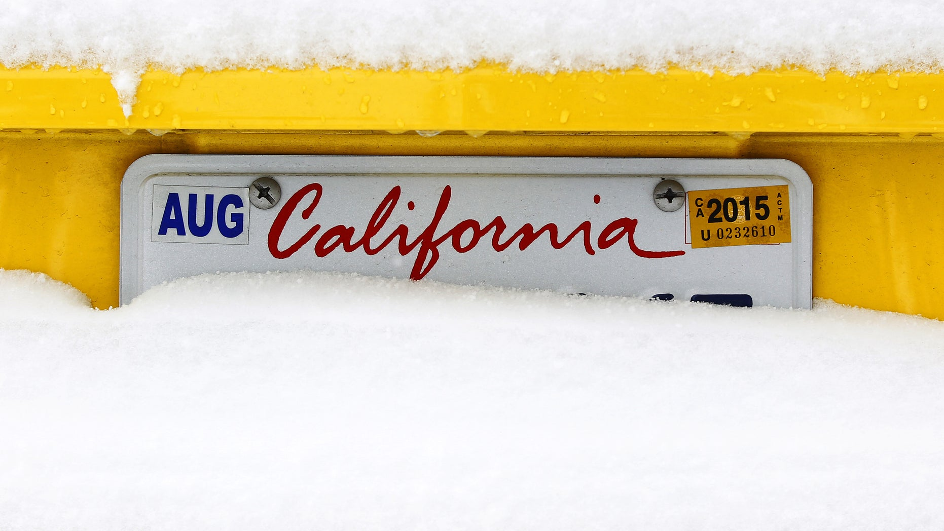 Dec. 31, 2014:  Chevrolet Camaro is covered in snow on Mount Laguna in the mountains east of San Diego.