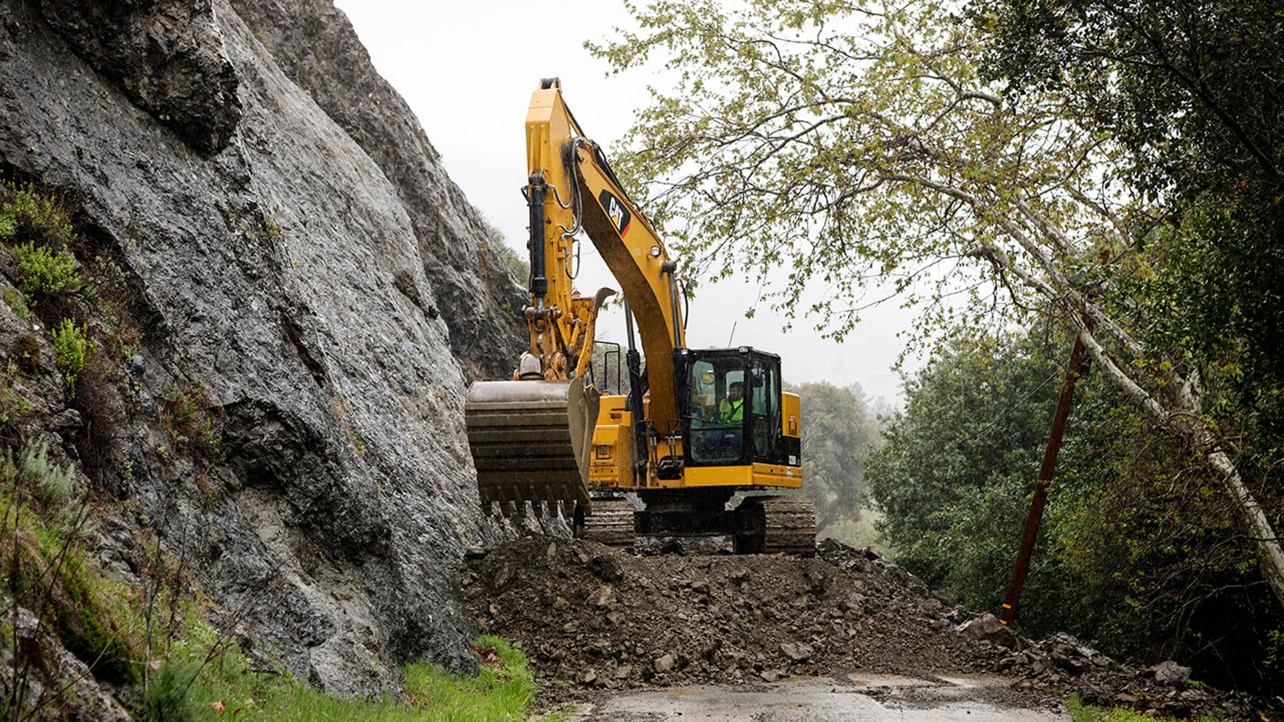 A crew works to clear Santa Rosa Creek Road after a rockslide in Cambria, Callif. Crews worked Wednesday, March 21, 2018, to clean up the rockslide.