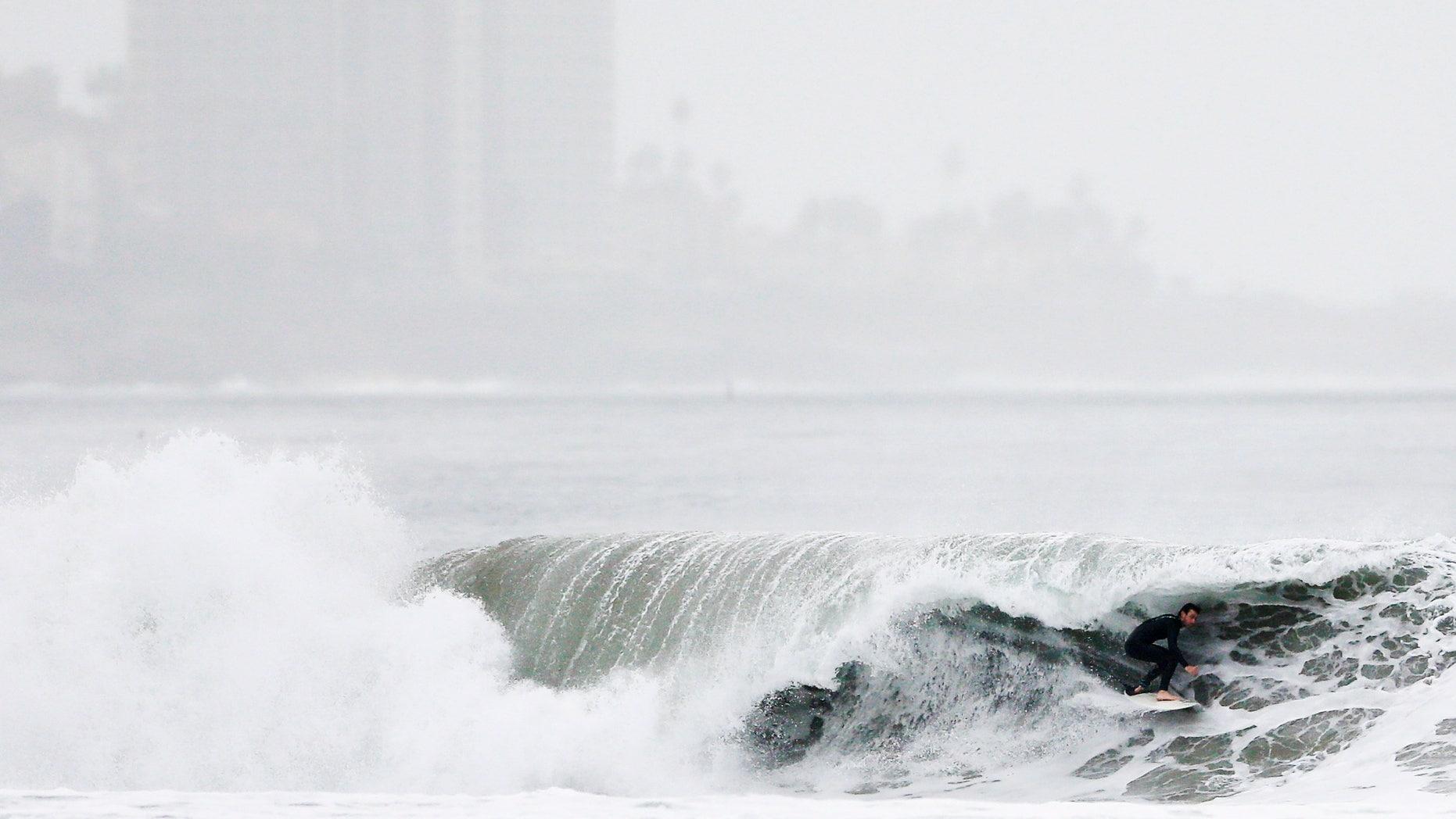 Dec. 16, 2014: A surfer rides a wave at Blacks Beach
