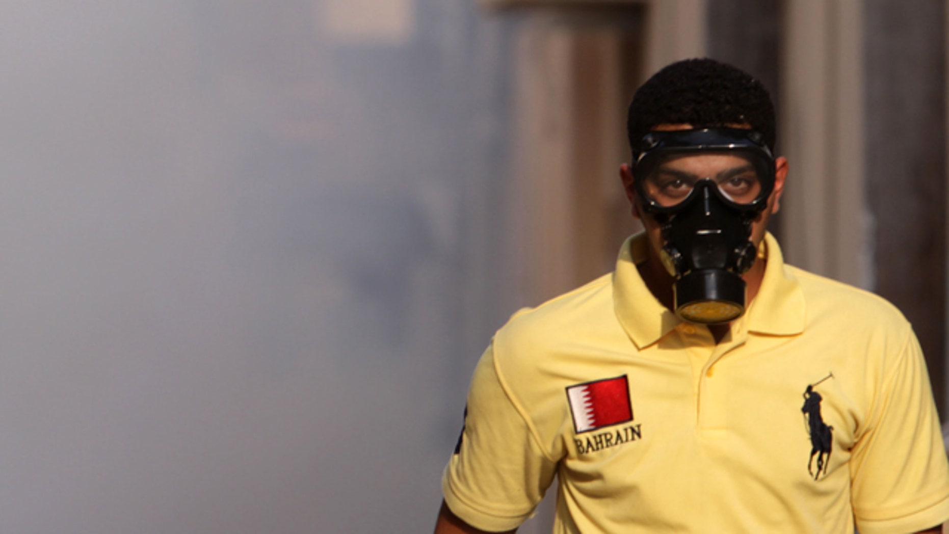 Sept. 24: A Bahraini man wearing a mask walks through tear gas during clashes between anti-government protesters and riot police n the Shiite village of Sanabis, Bahrain, on the edge of the capital of Manama.