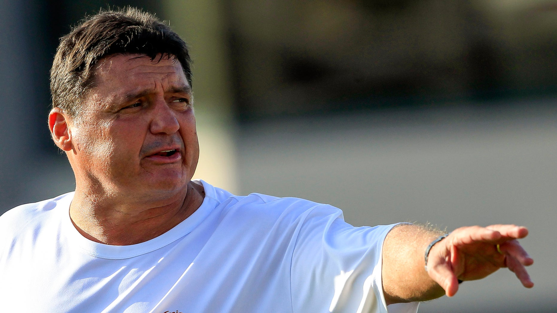 FILE- In this Oct. 2, 2013, file photo, Southern California's interim football coach Ed Orgeron guides his players during NCAA college football practice in Lo Angeles. The former Ole Miss coach welcomes the opportunity of his interim job, and the Trojans say he's injecting energy back into a weary team. (AP Photo/Damian Dovarganes, File)
