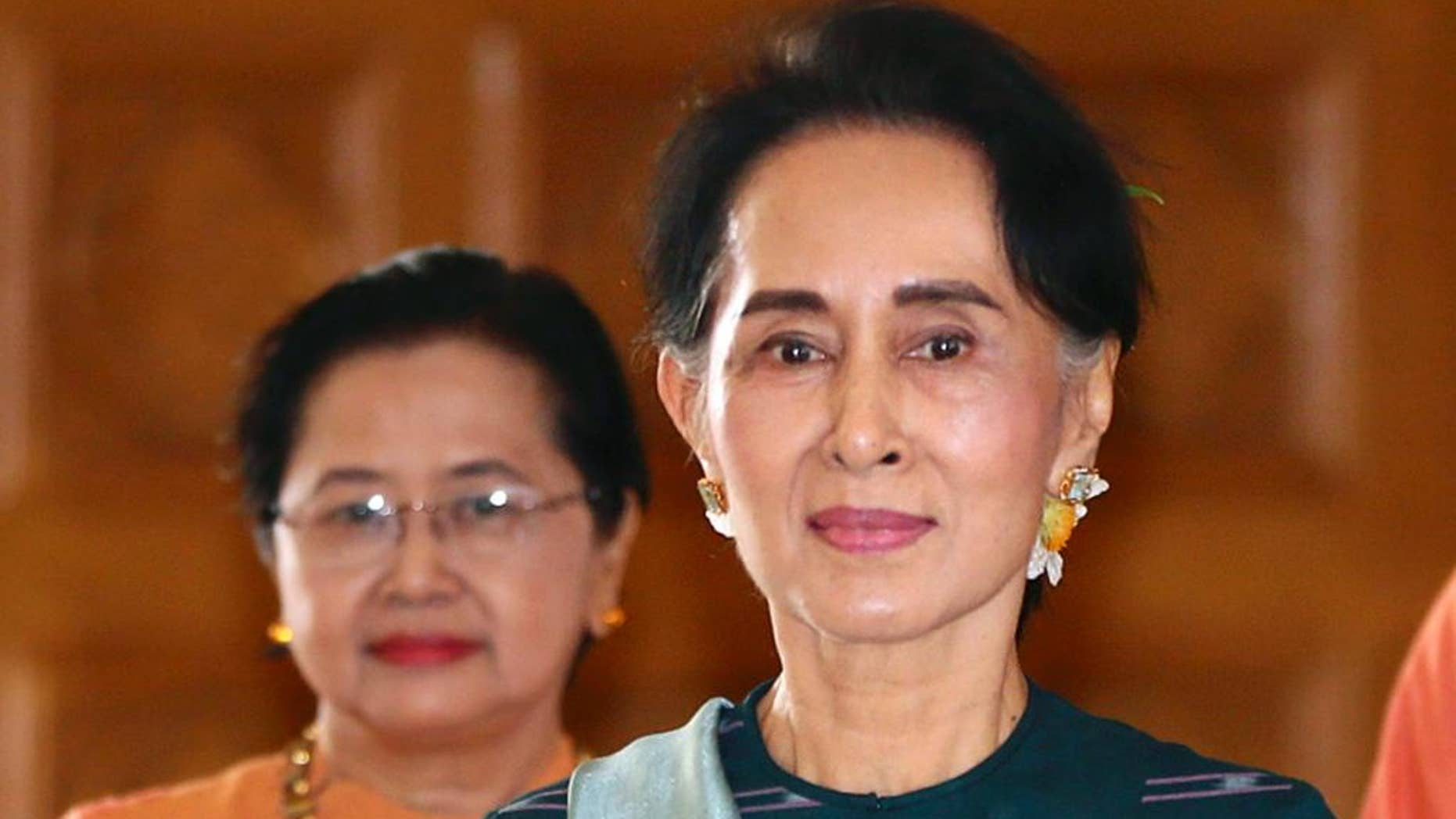 FILE - In this March 15, 2016 file photo, National League for Democracy party (NLD) leader Aung San Suu Kyi arrives at Myanmar's parliament in Naypyitaw, Myanmar. Amnesty International urged Aung San Suu Kyi and her party's new government to release all political prisoners when they take office next week, saying Thursday that Myanmar's historic transition is an opportunity to break away from the repression of the former junta rule. (AP Photo/Gemunu Amarasinghe, File)