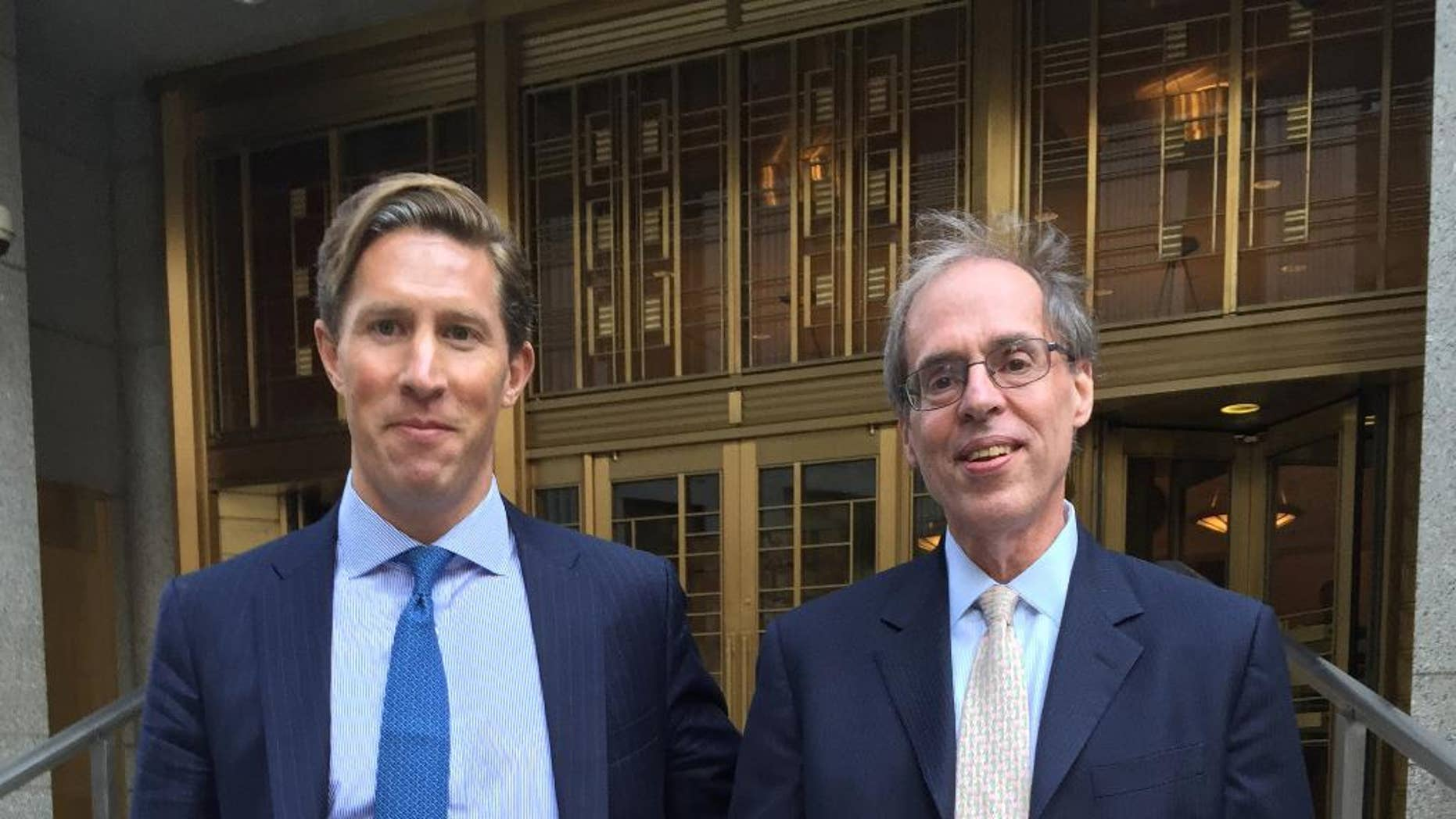 FILE- In this July 27, 2016 file photo, Sean Stewart, left, leaves Manhattan federal court in New York with his lawyer, Mark Gombiner, after opening statements in Stewart's insider trading trial. The Yale-educated investment banker was convicted of insider trading charges Wednesday, Aug. 17, 2016, after a jury concluded he gave tips about mergers and acquisitions to his father, enabling over $1 million in illegal profits. (AP Photo/Larry Neumeister, File)