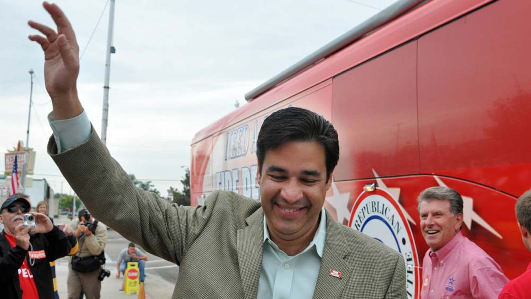 """Raul Labrador, Republican challenger for Idaho's first congressional district, waves to an enthusiastic crowd flanked by Idaho governor C.L. """"Butch"""" Otter, right, after arriving at a rally on Saturday October 9, 2010 in Caldwell, Idaho. Labrador, an attorney and two-term state lawmaker, is bidding to unseat Democrat Walt Minnick. (AP Photo/Idaho Press-Tribune, Mike Vogt)"""