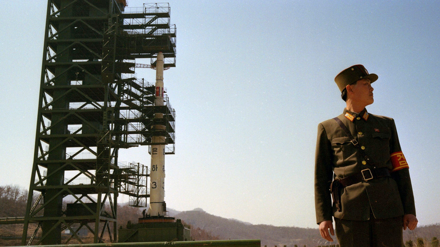 In this April 8, 2012 photo, North Korean soldiers stand guard in front of the country's Unha-3 rocket at Sohae Satellite Station in Tongchang-ri, North Korea. The Kwangmyongsong-3 satellite was launched on April 13, 2012 but failed to reach orbit. (AP Photo/David Guttenfelder)
